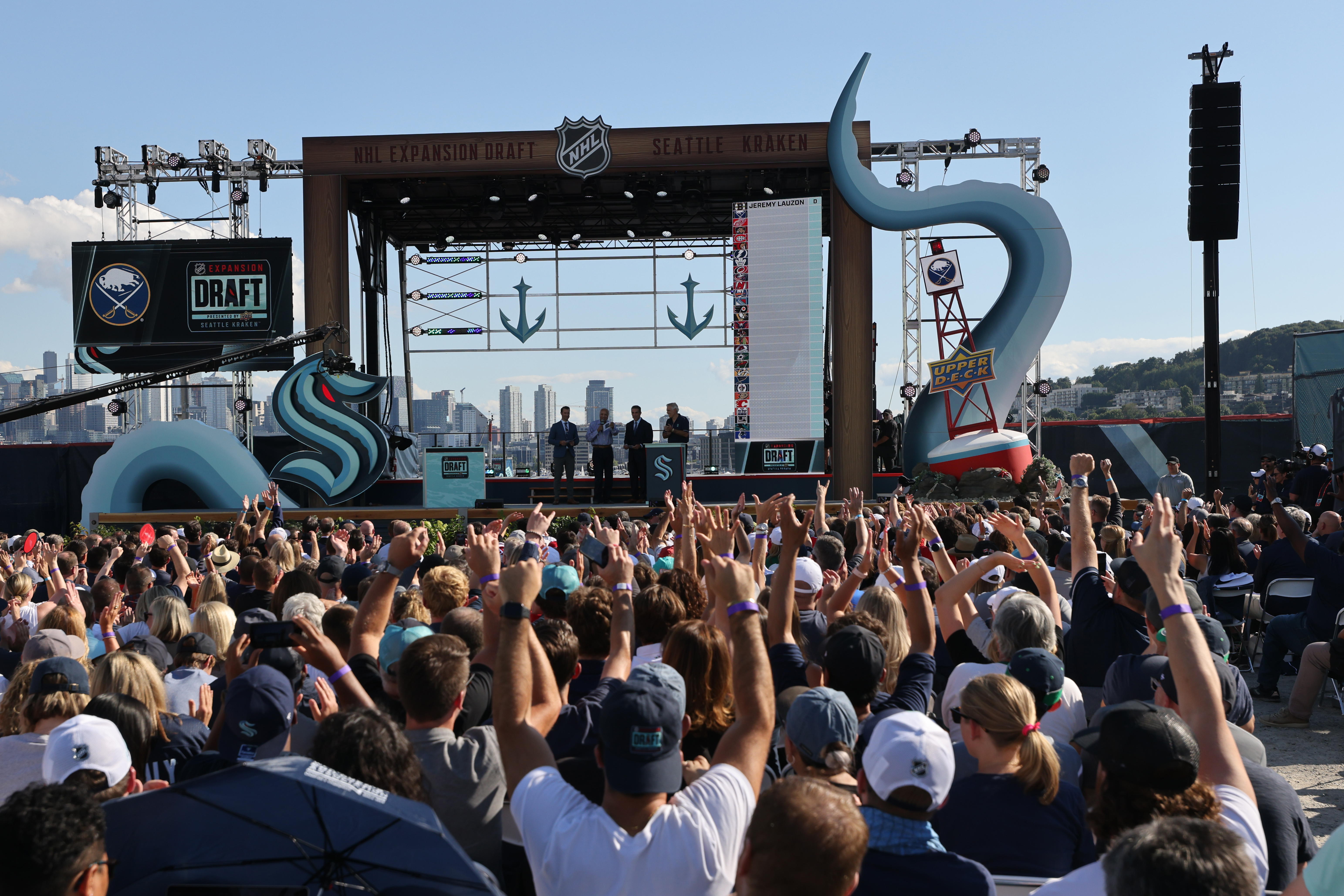 Fans cheer during the Seattle Kraken 2021 NHL expansion draft at Gas Works Park on July 21, 2021 in Seattle, Washington. Thousands of free tickets were available to fans to attend this live broadcast event on ESPN2 to watch the Kraken make 30 selections to build their first roster in franchise history. Boats were encouraged to sail-gate.
