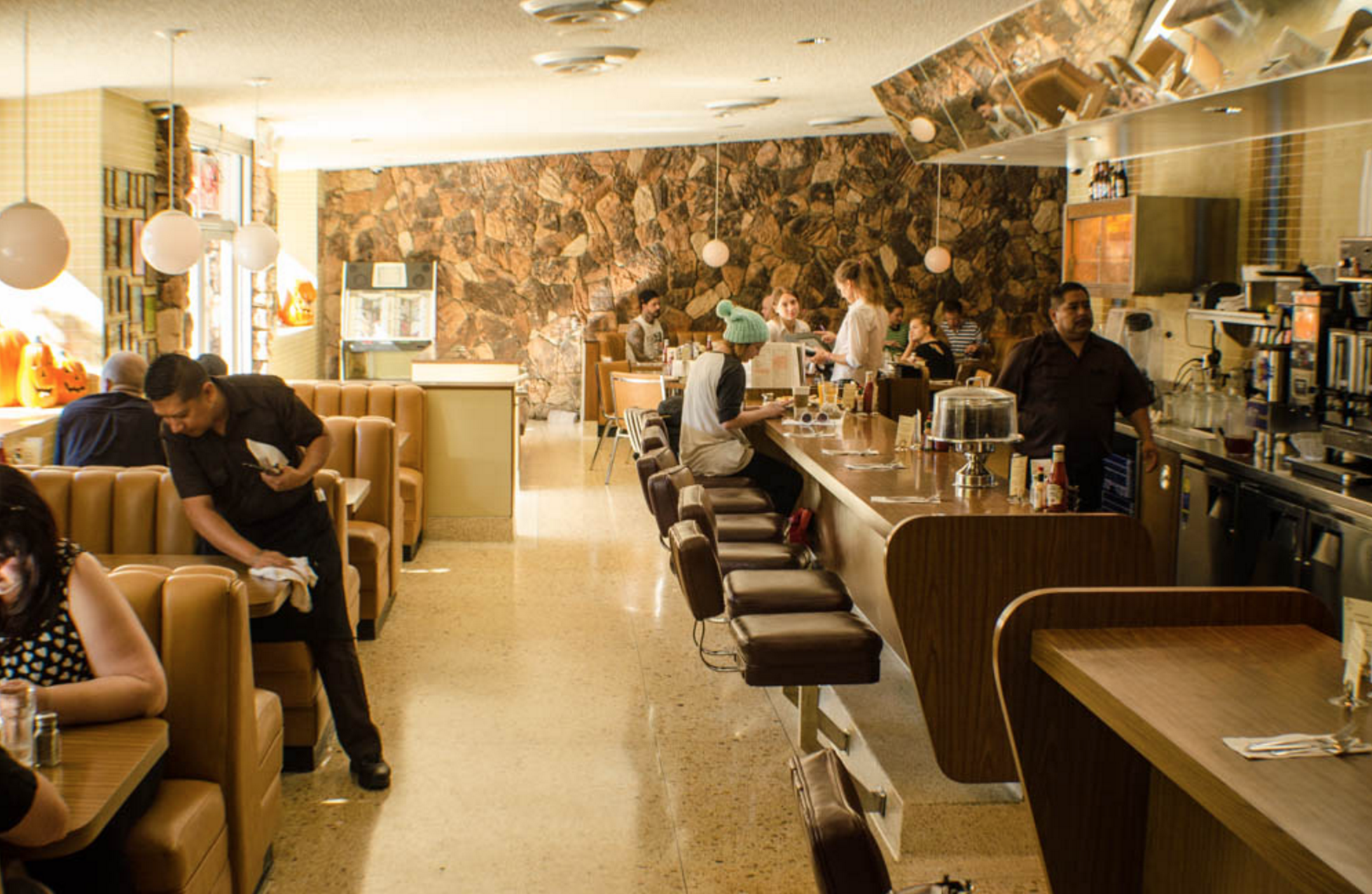 101 Coffee Shop is shown as a tan backdrop for a diner with rock walls and big booths.