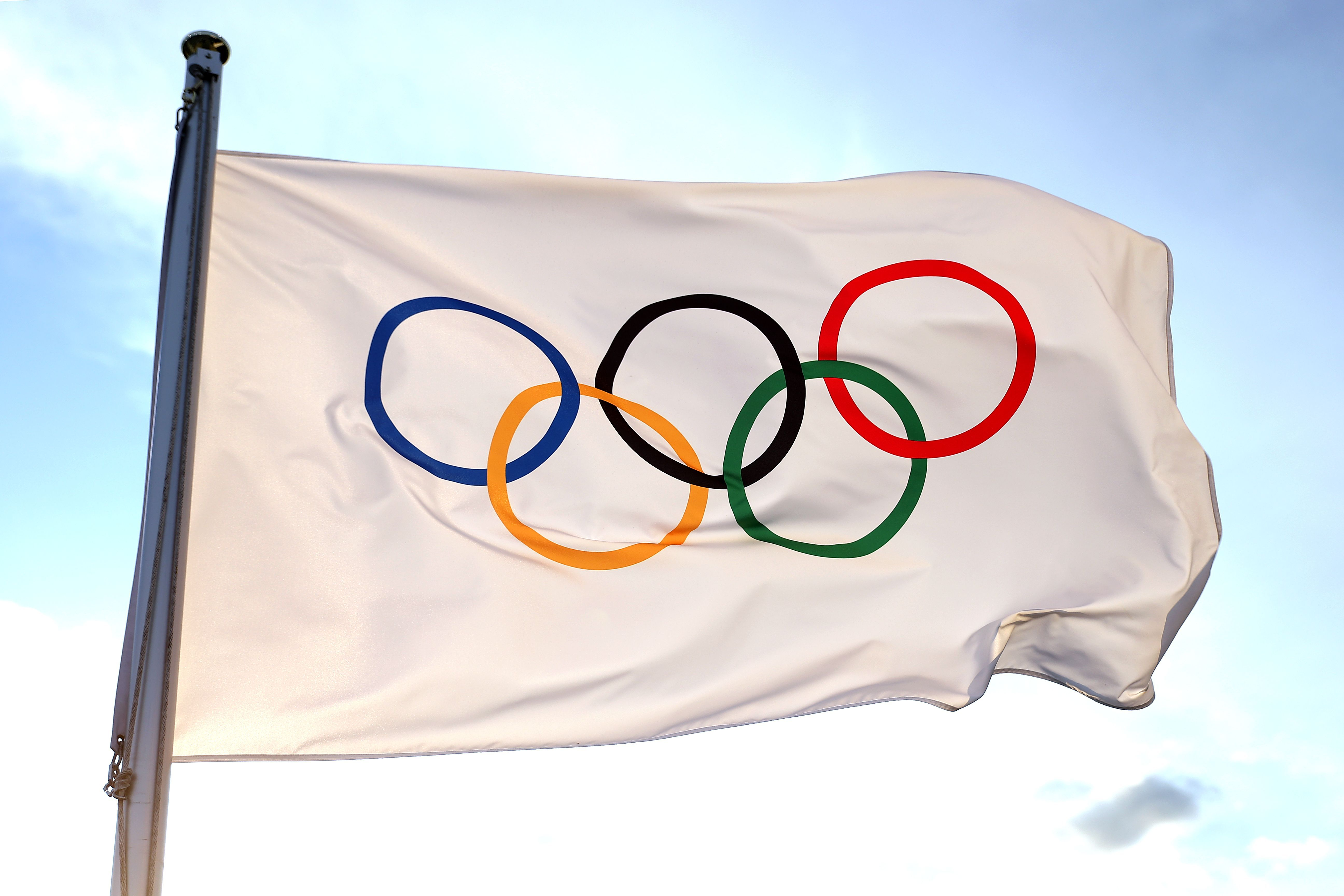 an Olympic flag: the Olympic logo of five colored rings on a white background