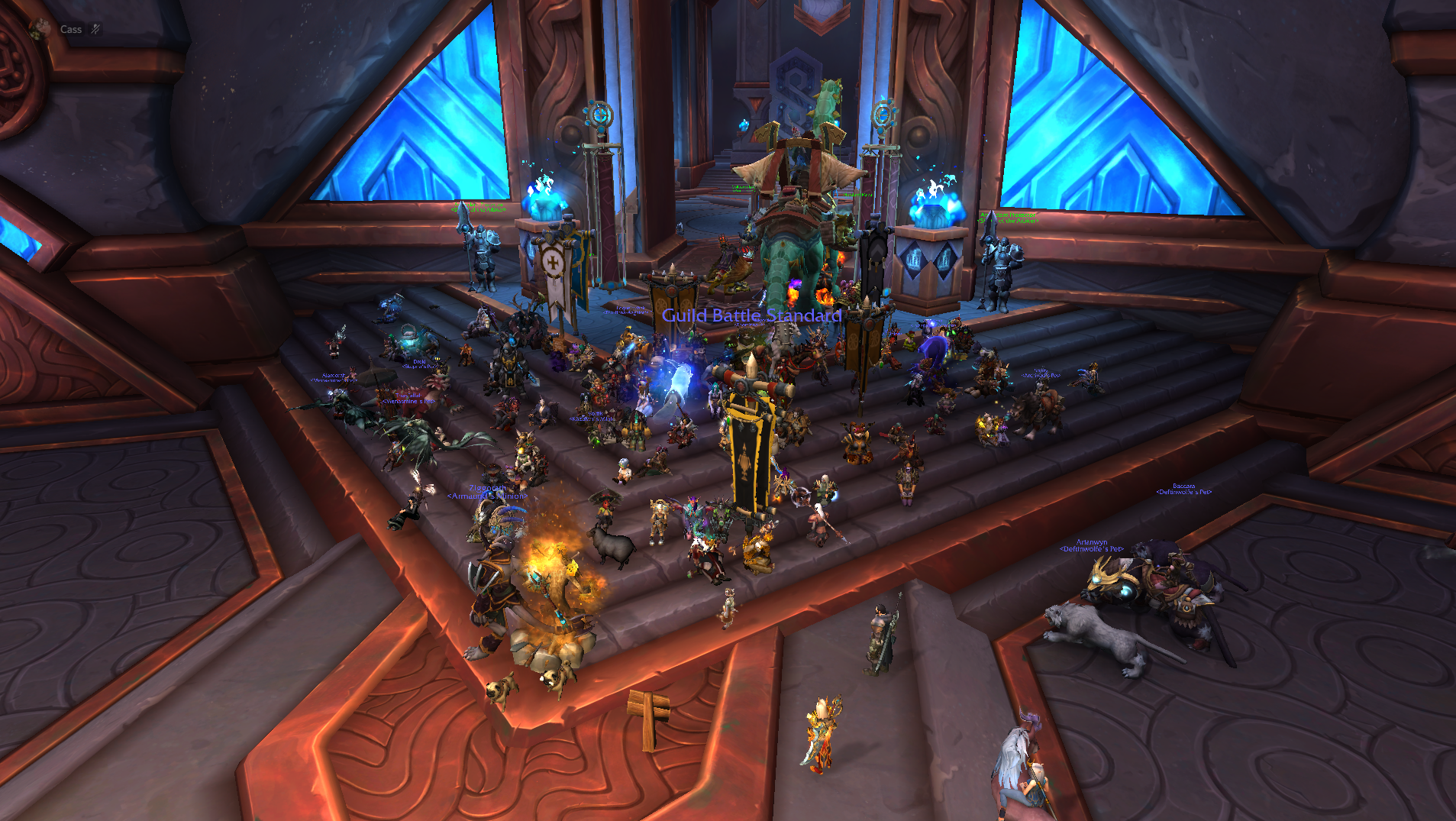 World of Warcraft - a shot of dozens of players sitting together in the Shadowlands city of Oribos for an in-game sit-in protest