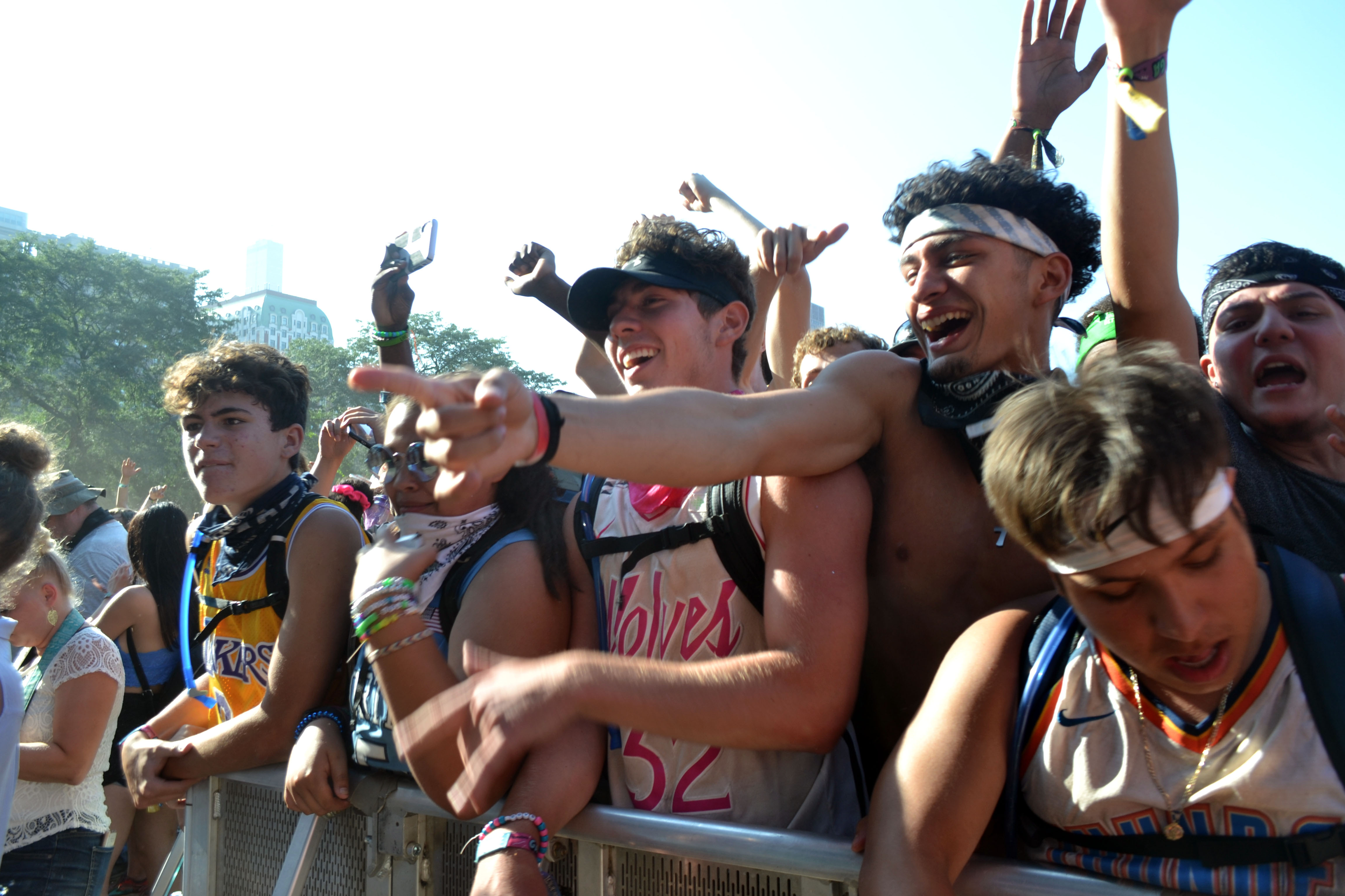 Concertgoers cheer at Lollapalooza in August 2019. The festival returns to Grant Park next week despite ongoing concerns about COVID-19.