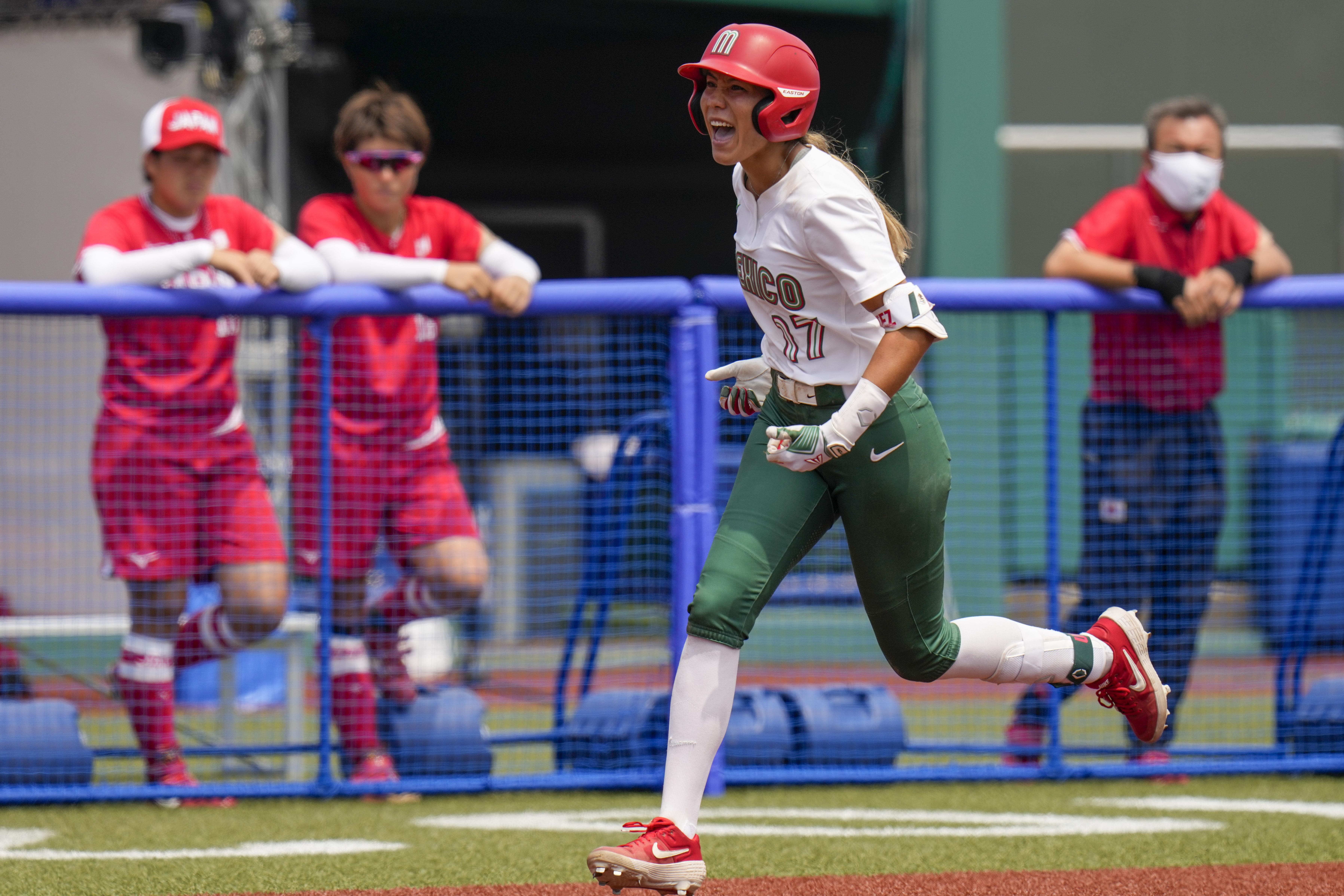 Mexico's Anissa Urtez celebrates as she hits a home run.
