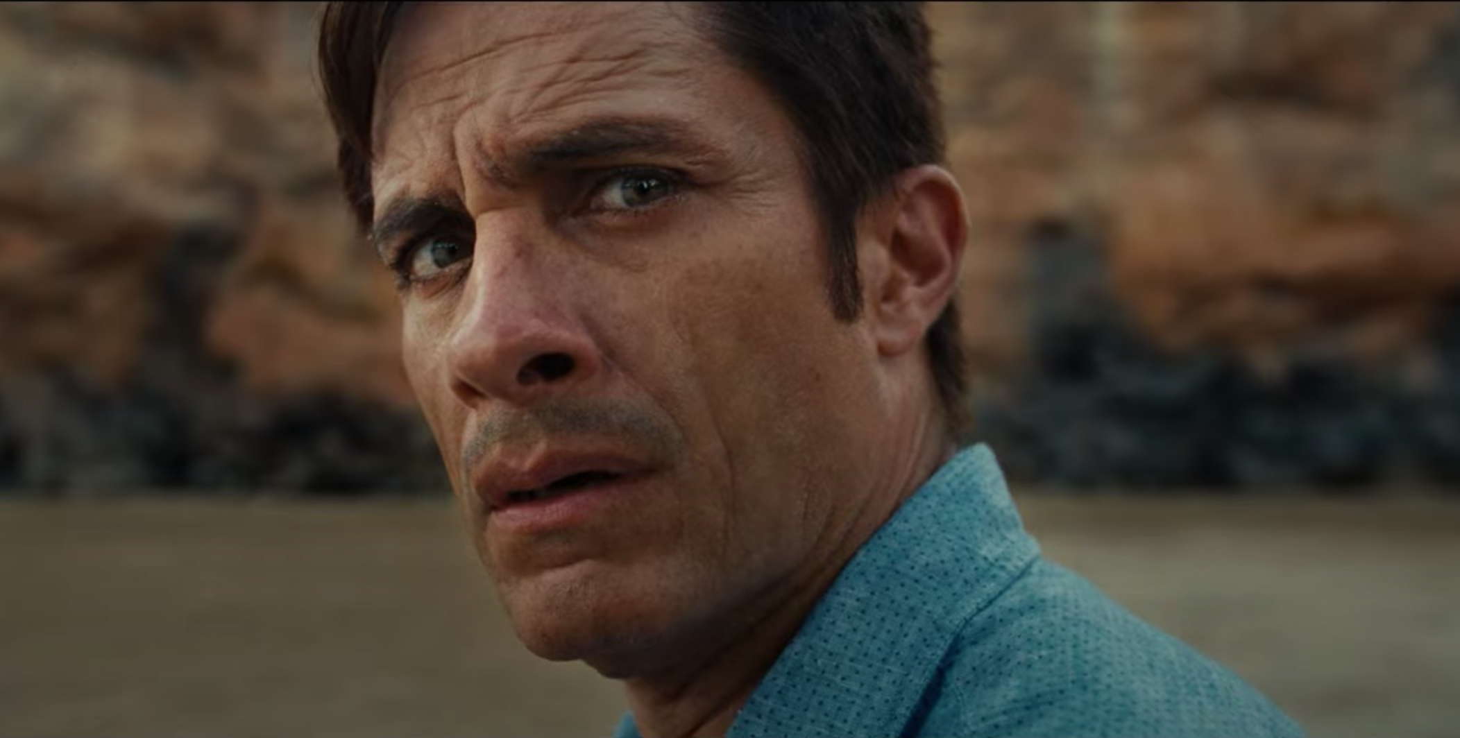 A close-up of Gael García Bernal's face. He looks confused.
