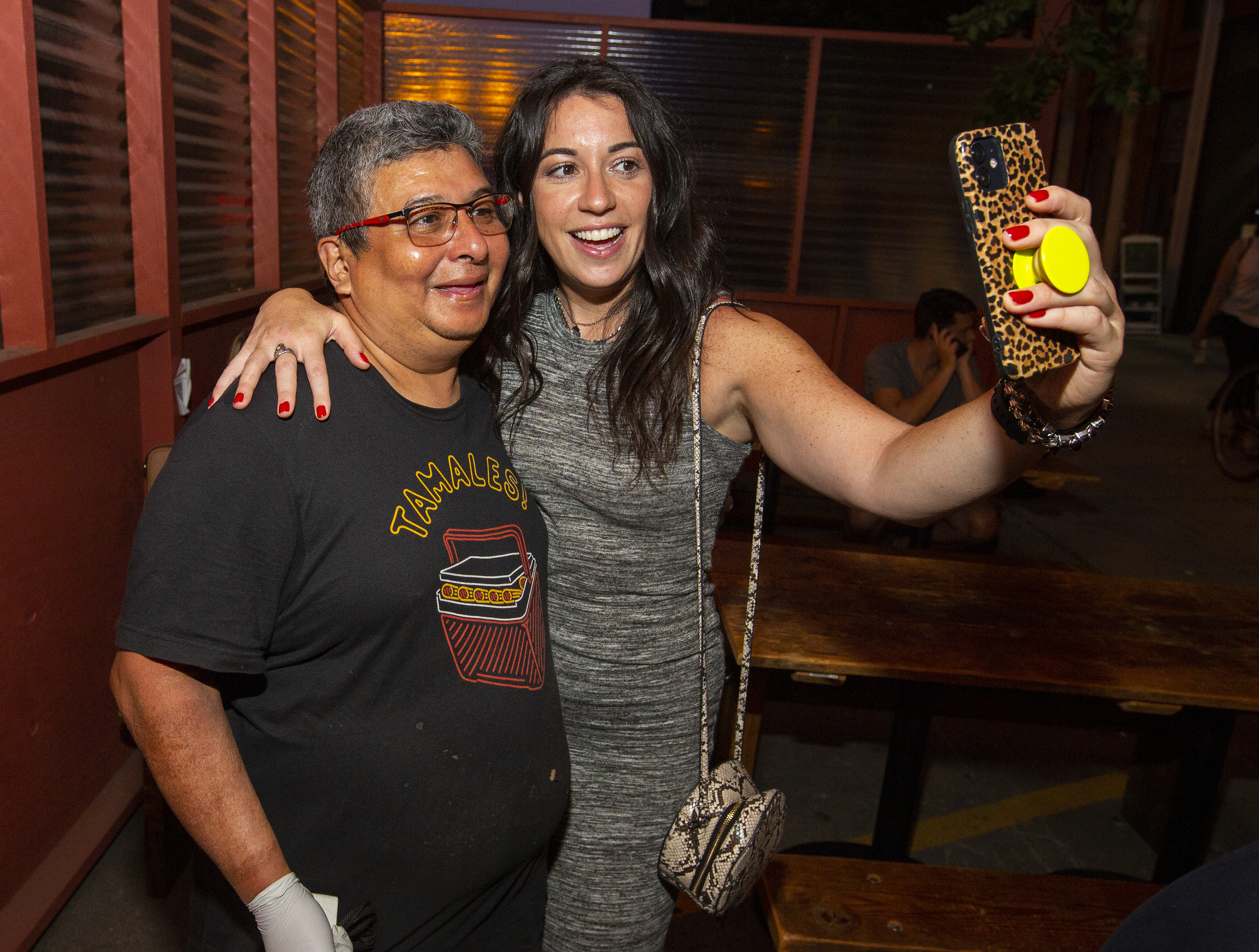 Two people standing up and taking a selfie.