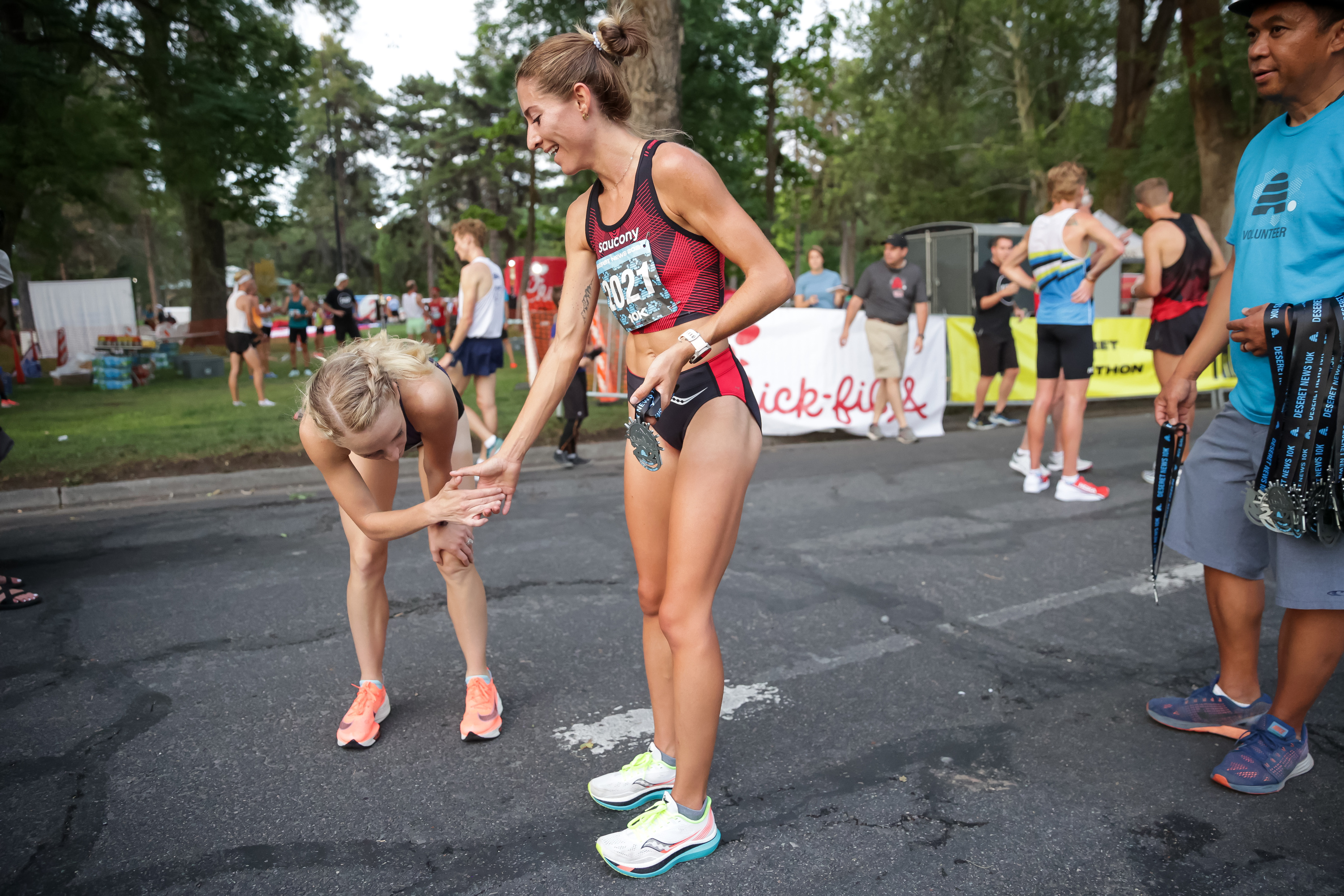 Grayson Murphy, right, who won the women's division of the Deseret News 10K, congratulates second-place finisher Lexie Thompson at Liberty Park in Salt Lake City on Friday, July 23, 2021.