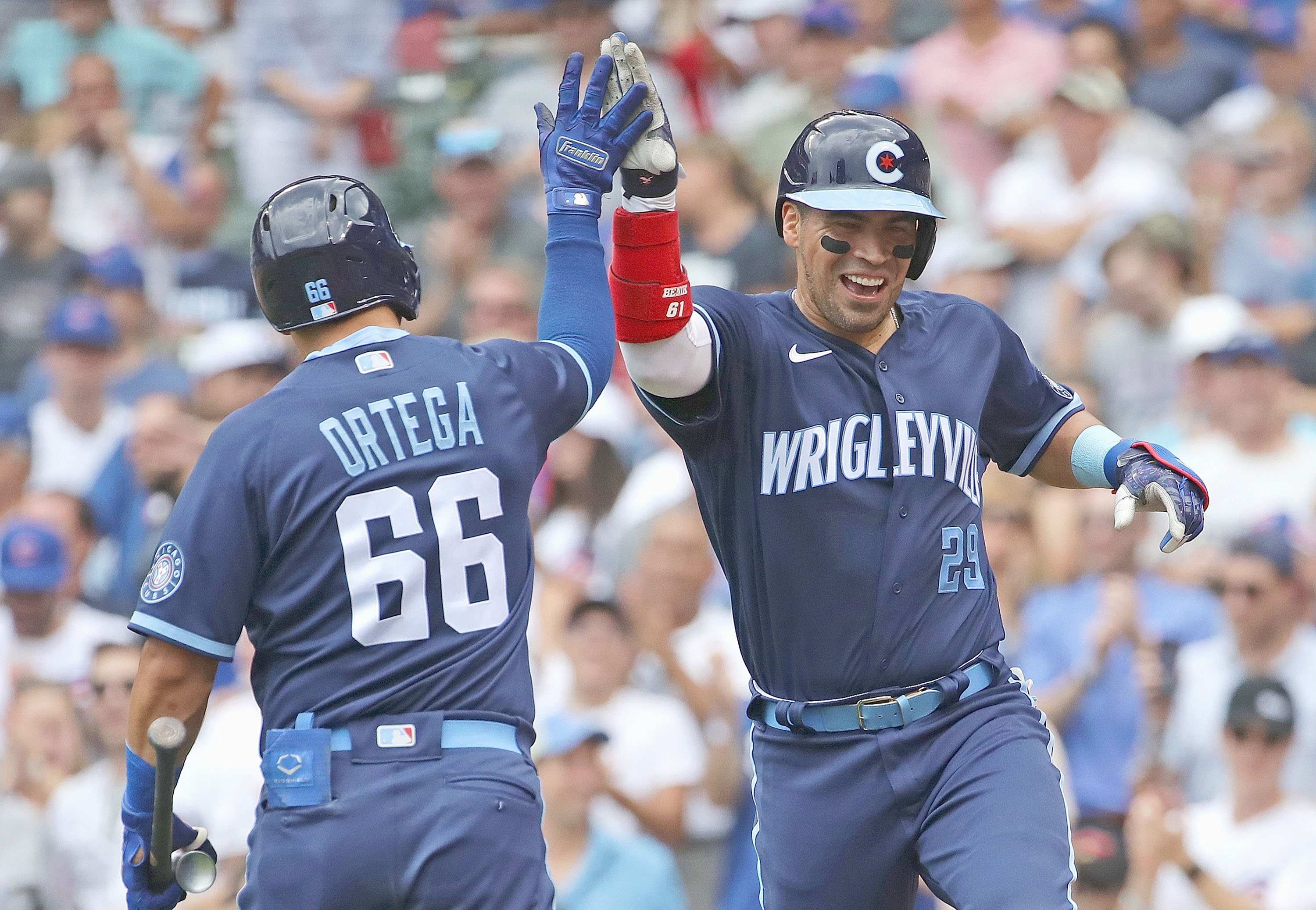 Robinson Chirinos (right) celebrates after hitting a solo home run with teammate Rafael Ortega during the fourth inning Friday against the Diamondbacks at Wrigley Field.