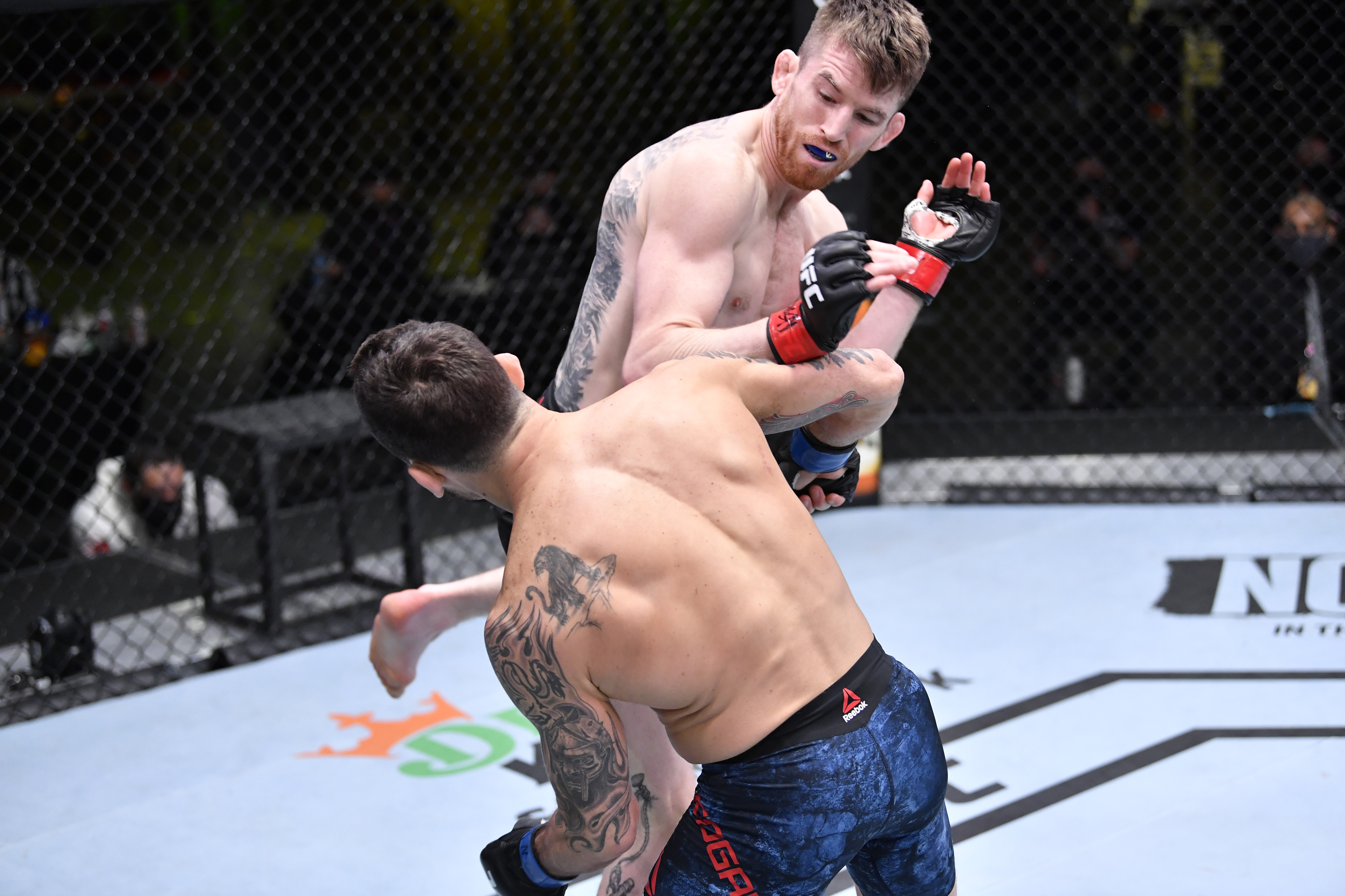 Cory Sandhagen lands a flying knee to knock out Frankie Edgar in their bantamweight fight during the UFC Fight Night event at UFC APEX on February 06, 2021 in Las Vegas, Nevada.