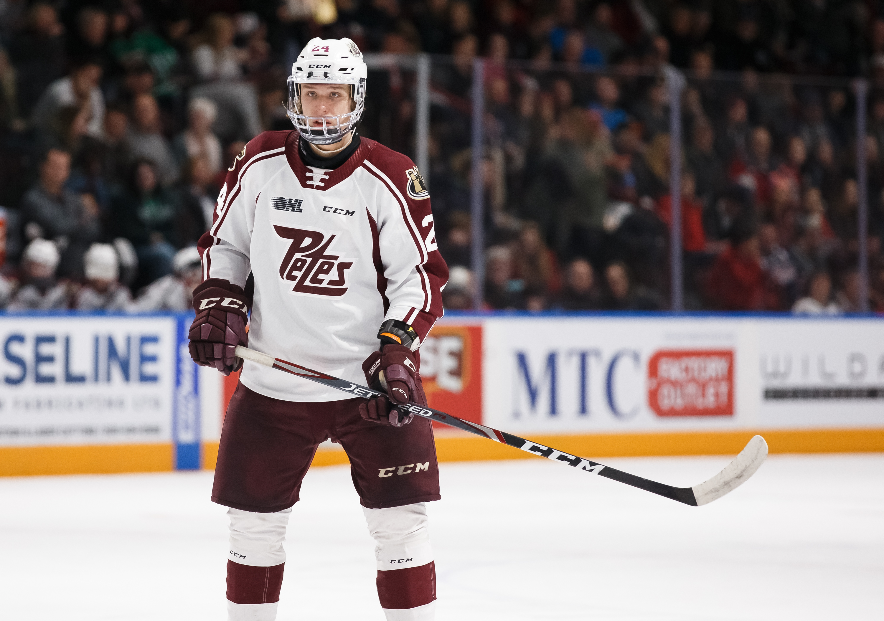 Artem Guryev #24 of the Peterborough Petes looks on before a face-off during an OHL game against the Oshawa Generals at the Tribute Communities Centre on January 31, 2020 in Oshawa, Ontario, Canada.