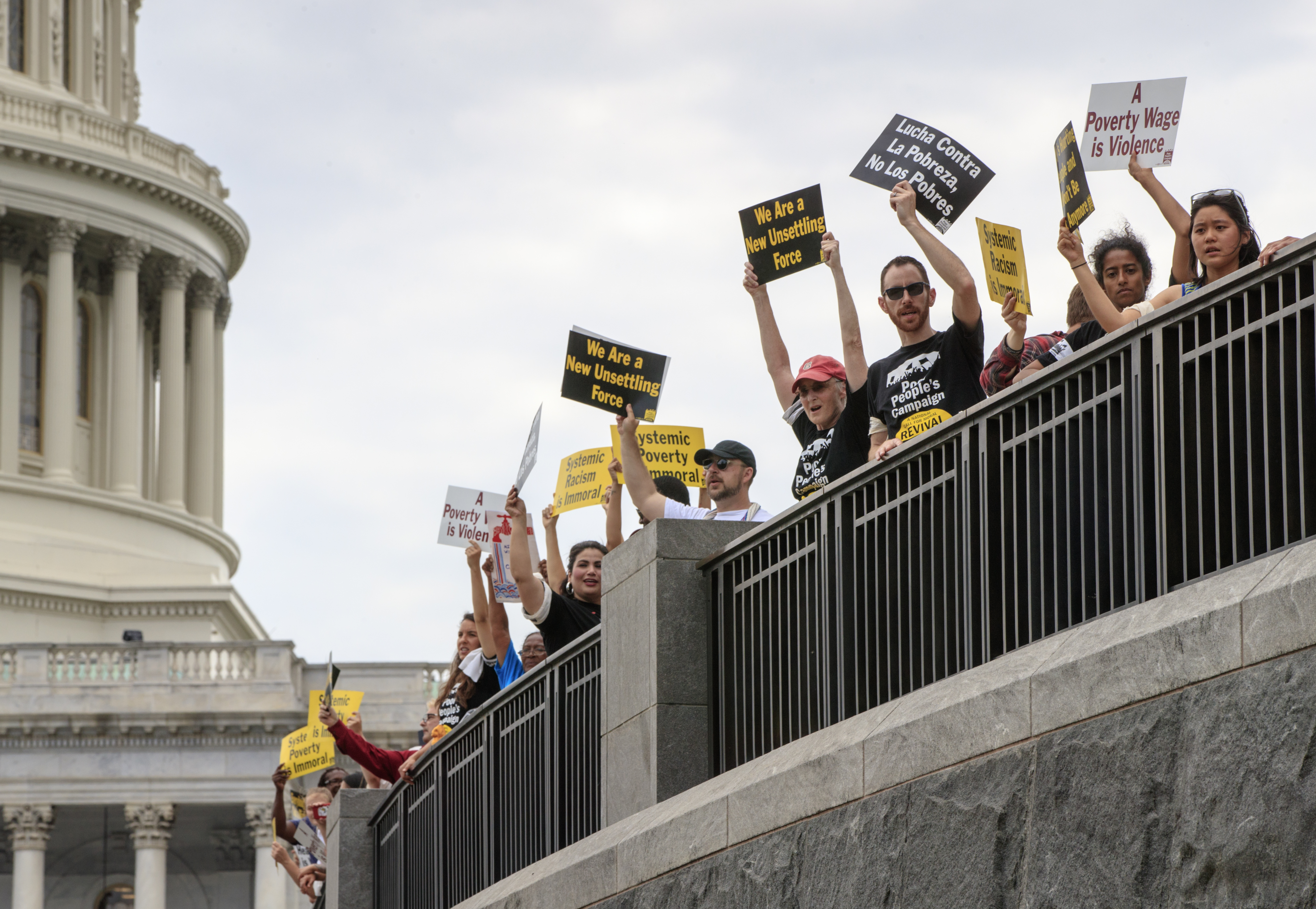Demonstrators with the Poor People's Campaign await processing by U.S. Capitol Police after being peacefully arrested in 2018.