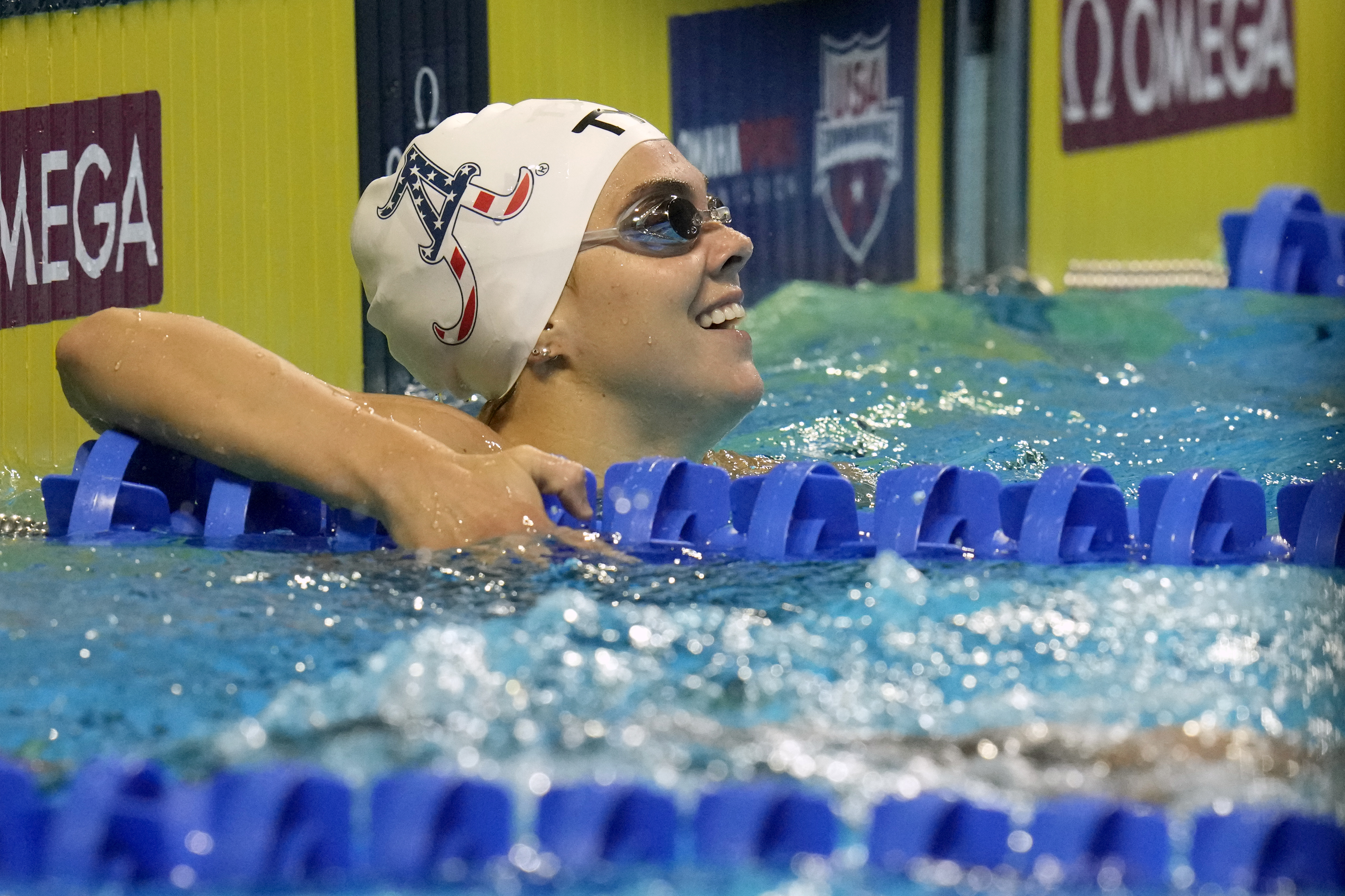 Rhyan White smiles after the women's 200-meter backstroke during wave 2 of the U.S. Olympic Swim Trials on Saturday, June 19, 2021, in Omaha, Neb.
