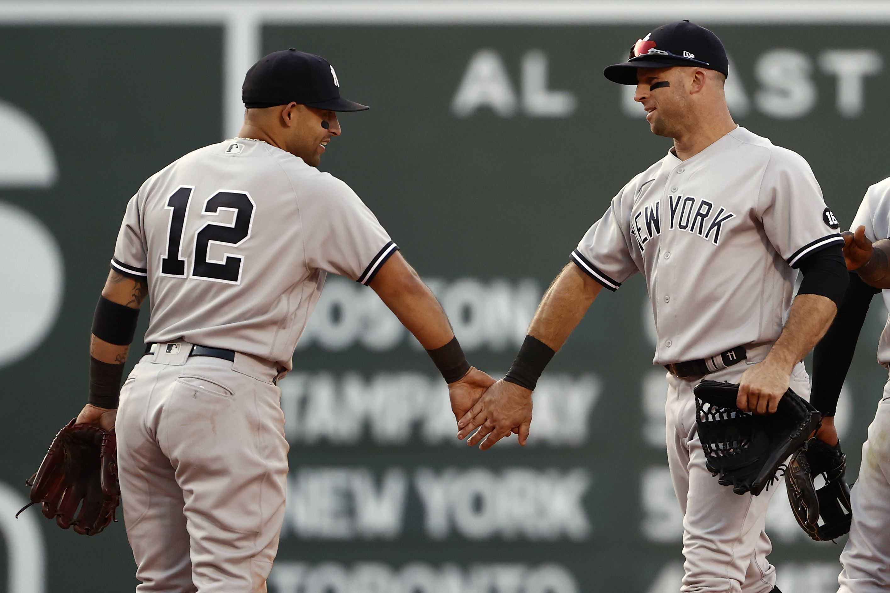Rougned Odor of the New York Yankees and Brett Gardner congratulate each other after their 4-3 win over the Boston Red Sox at Fenway Park on July 24, 2021 in Boston, Massachusetts.