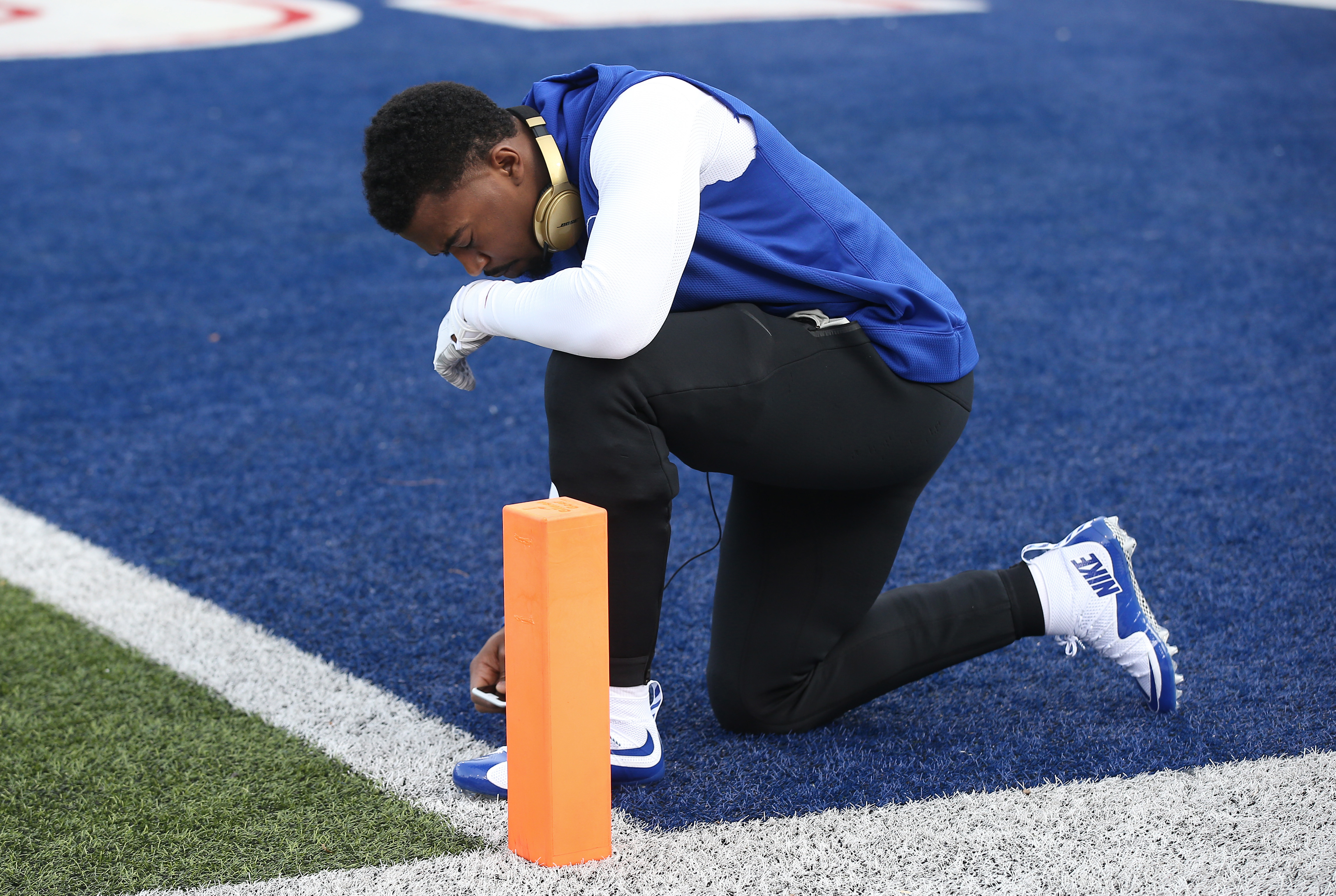 Tyrod Taylor #5 of the Buffalo Bills says a prayer prior to warming up before playing against the Houston Texans during NFL game action at Ralph Wilson Stadium on December 6, 2015 in Orchard Park, New York.