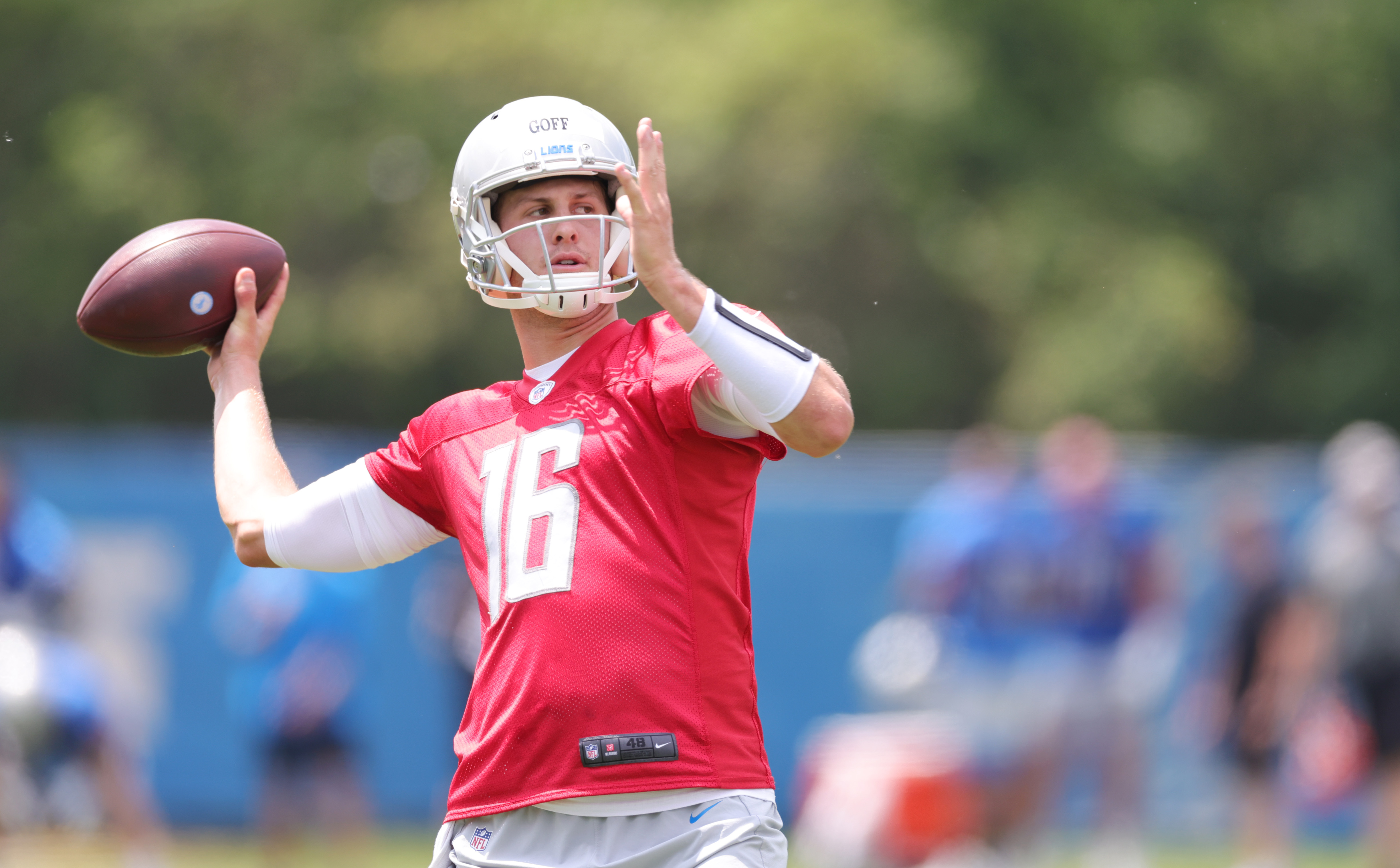 Jared Goff #16 of the Detroit Lions drops back to pass during the afternoon practice session on June 09, 2021 in Allen Park, Michigan.