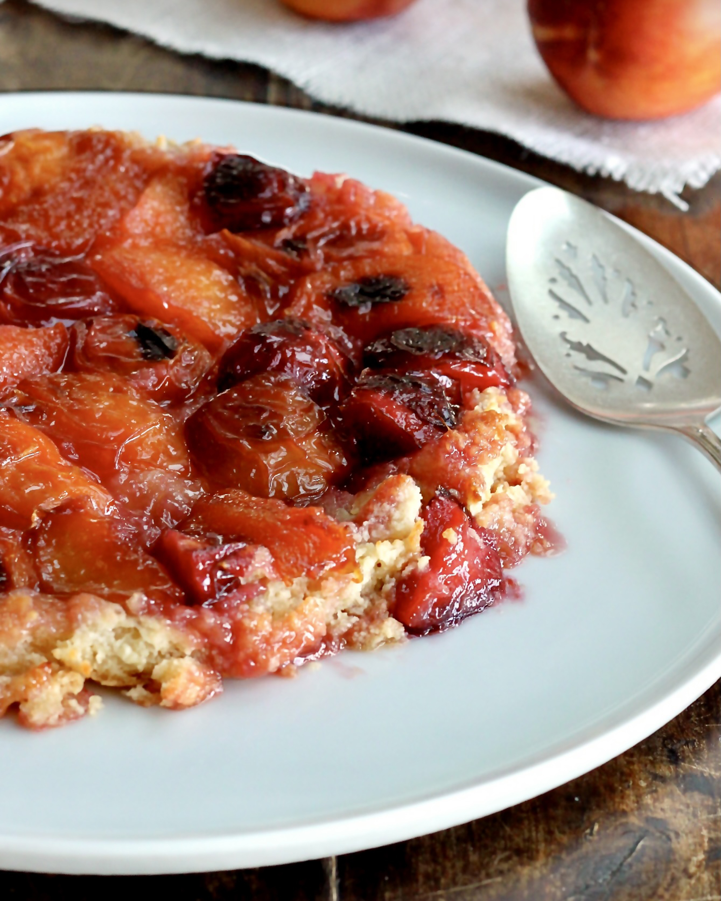 In this tarte Tatin recipe, the sweet tang of nectarines and plums melds beautifully with the caramel base, which then becomes the topping.