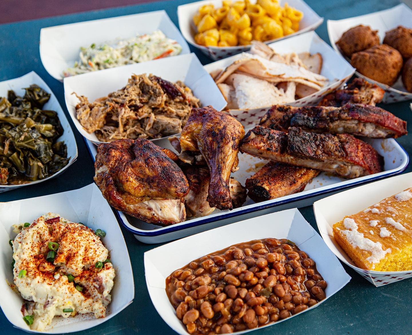 """""""Taste Plate"""" barbecue plate from Rodney Scott's with potato salad, baked beans, corn bread, ribs, chicken, collards, pulled pork, smoked turkey"""