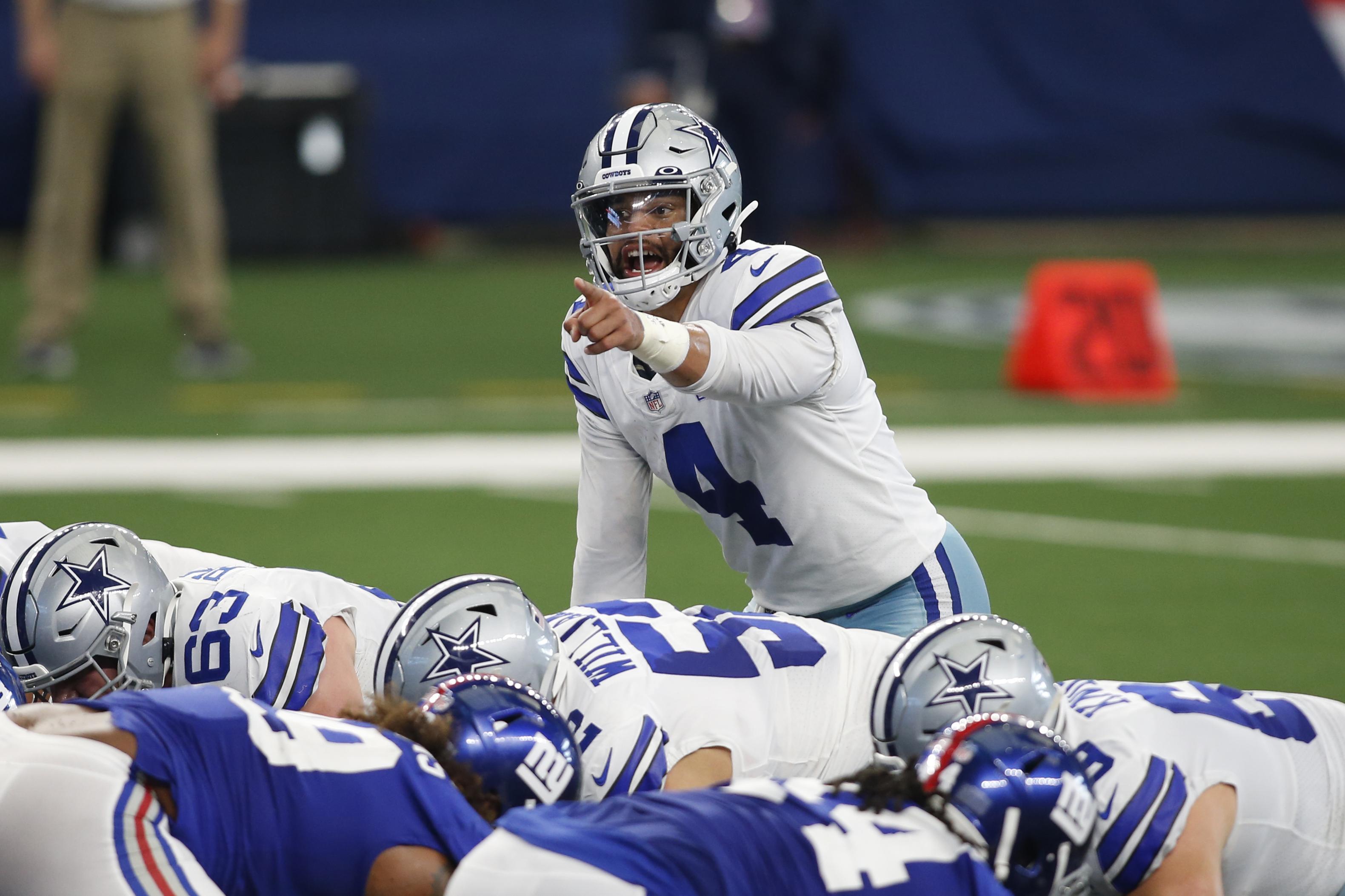 Dallas Cowboys quarterback Dak Prescott (4) calls a play in the second quarter against the New York Giants at AT&T Stadium.
