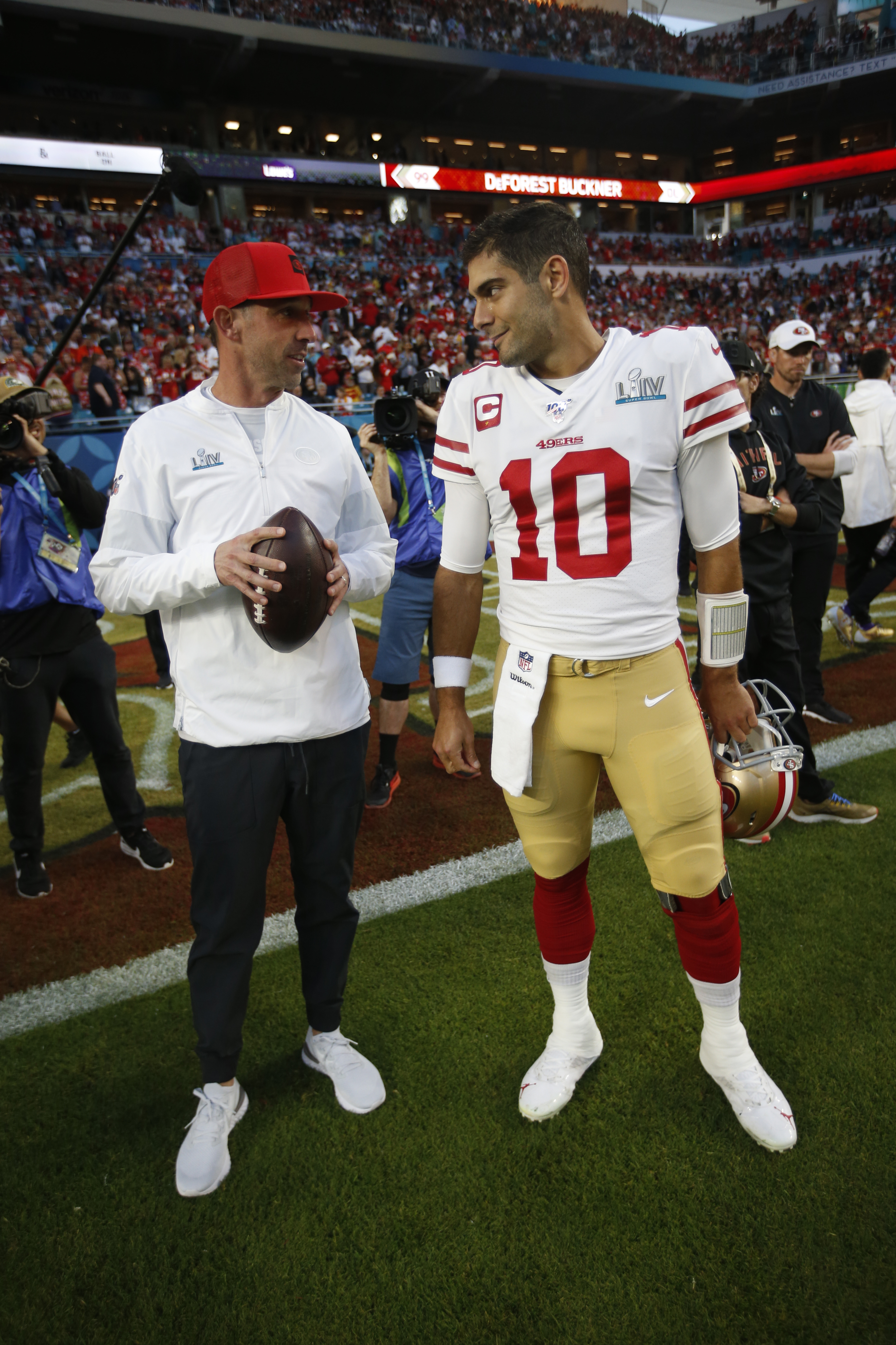 Head Coach Kyle Shanahan and Jimmy Garoppolo #10 of the San Francisco 49ers talk on the field before the game against the Kansas City Chiefs in Super Bowl LIV at Hard Rock Stadium on February 2, 2020 in Miami, Florida.