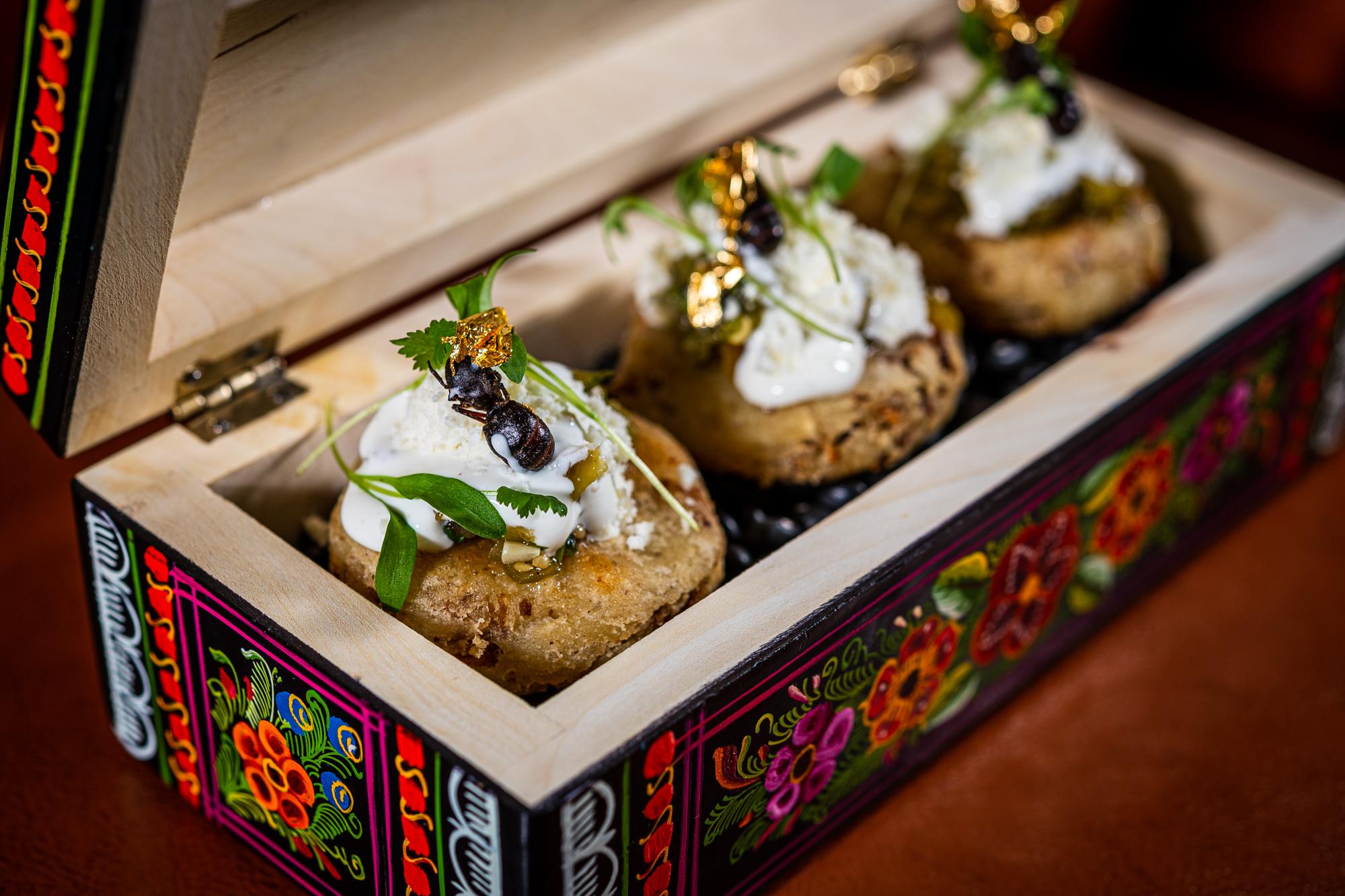 The namesake flying ants at Chicatana decorate bunuelos for dessert