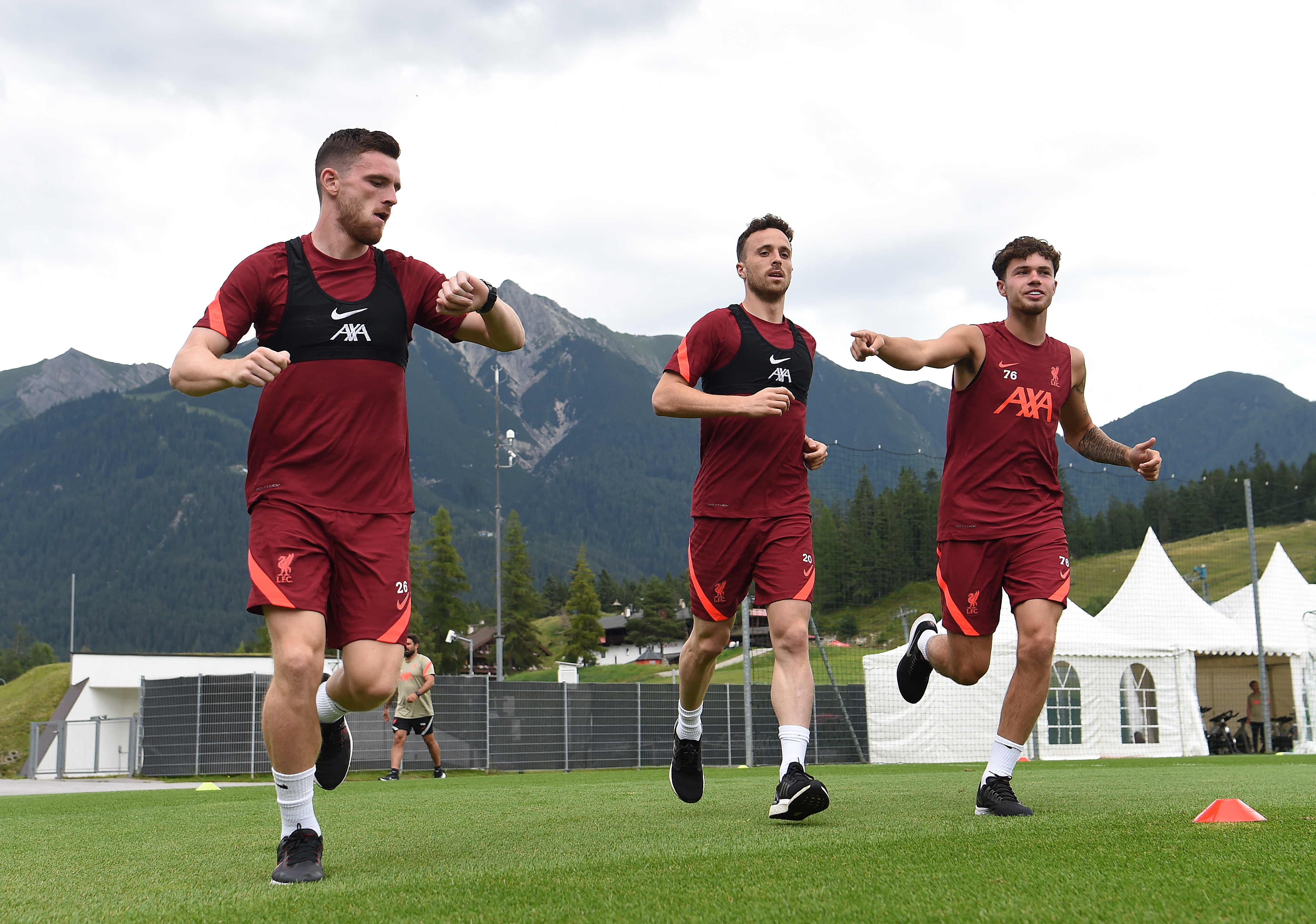 Andy Robertson, Diogo Jota and Neco Williams of Liverpool during a training session on July 26, 2021