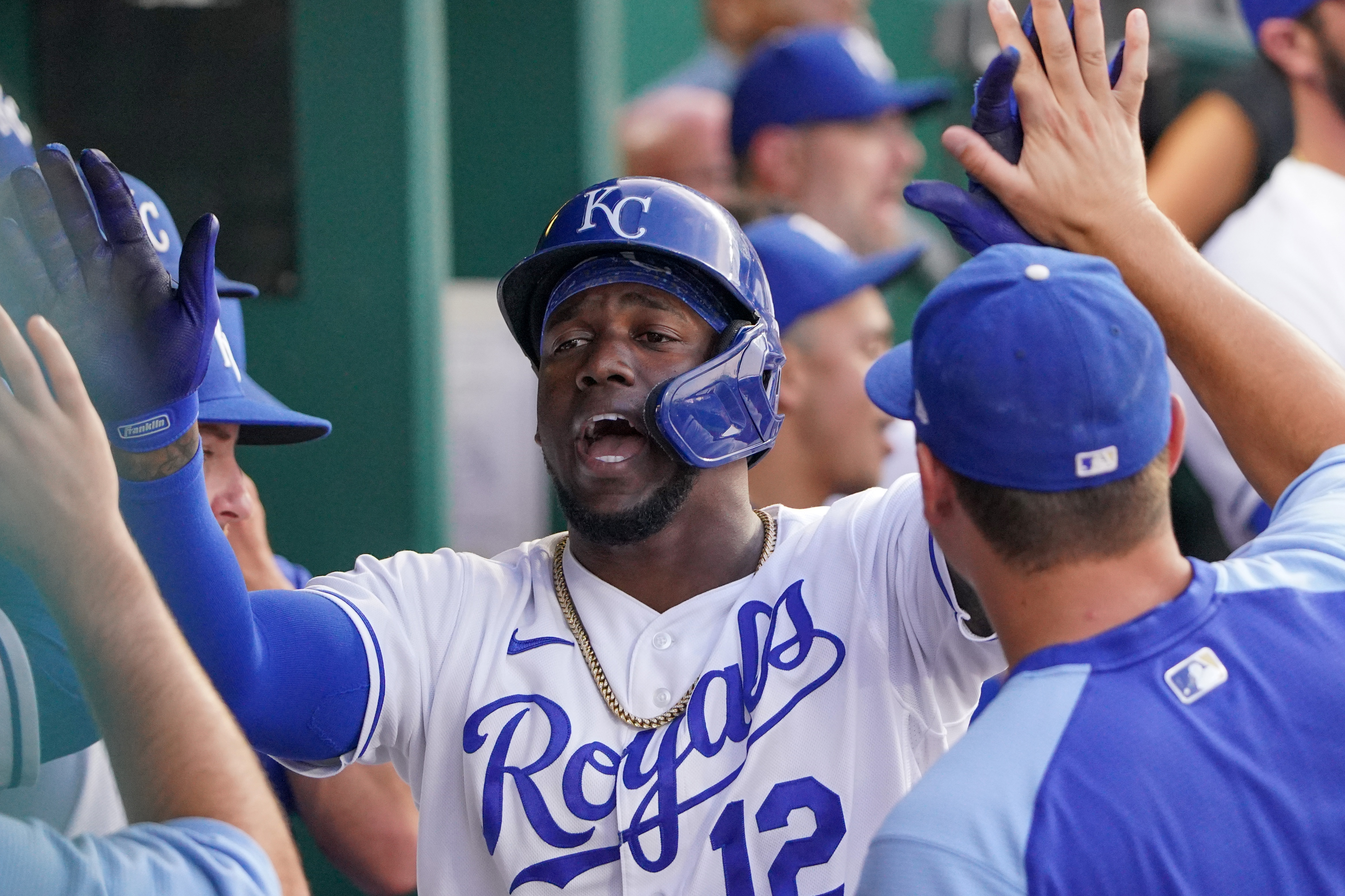Kansas City Royals designated hitter Jorge Soler (12) is congratulated in the dugout after hitting a solo home run in the fourth inning against the Chicago White Sox at Kauffman Stadium.