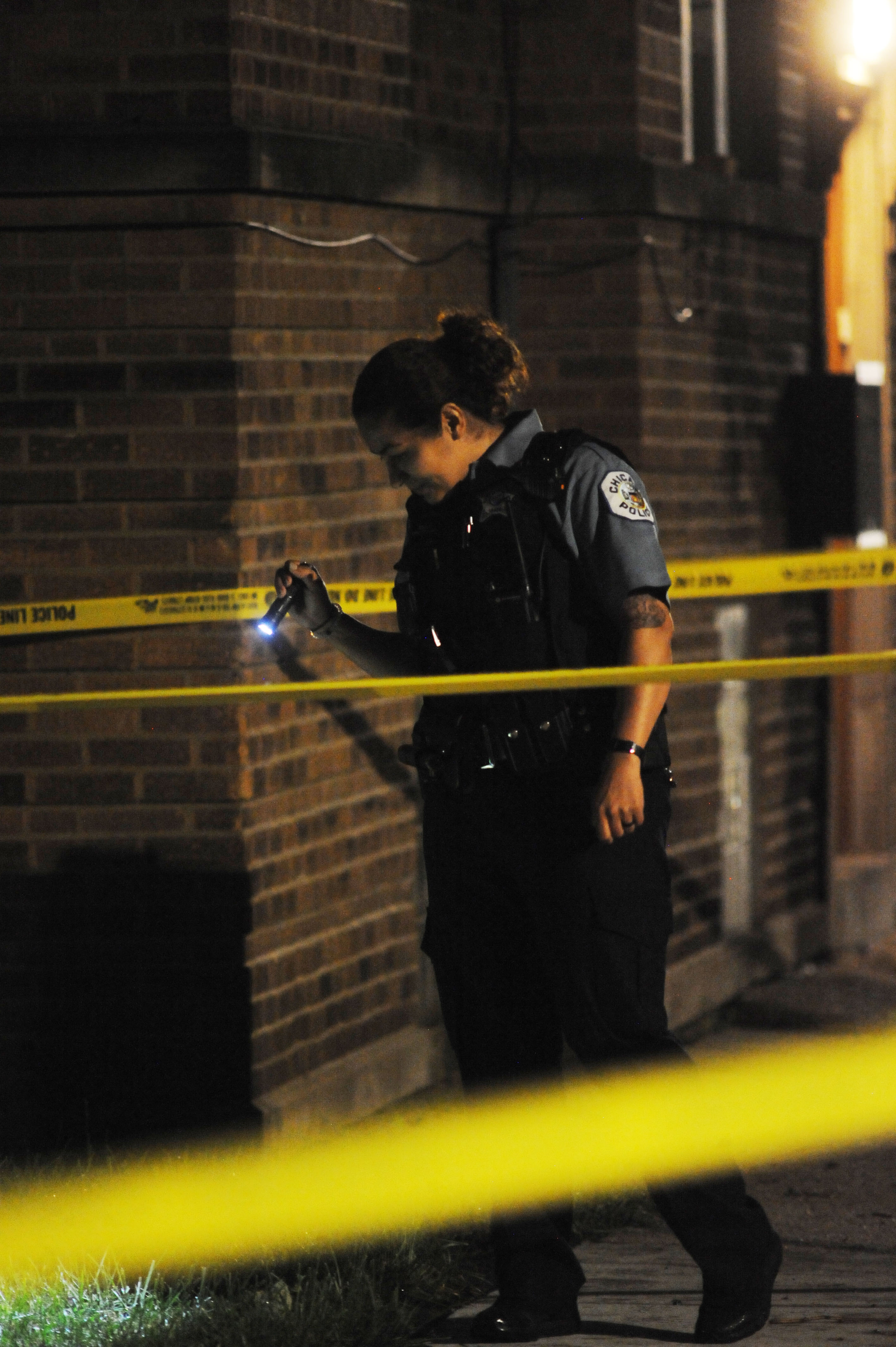 Photo of officers investigating the scene of a shooting in the 8700 block of South Ada Street
