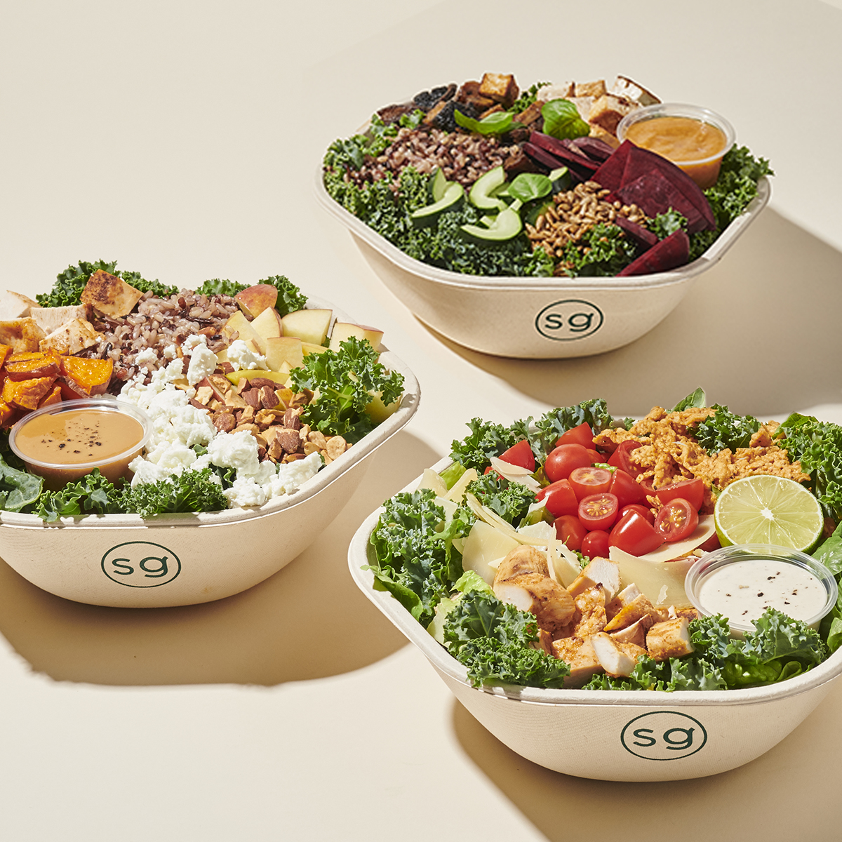Three bowls of salad from Sweetgreen