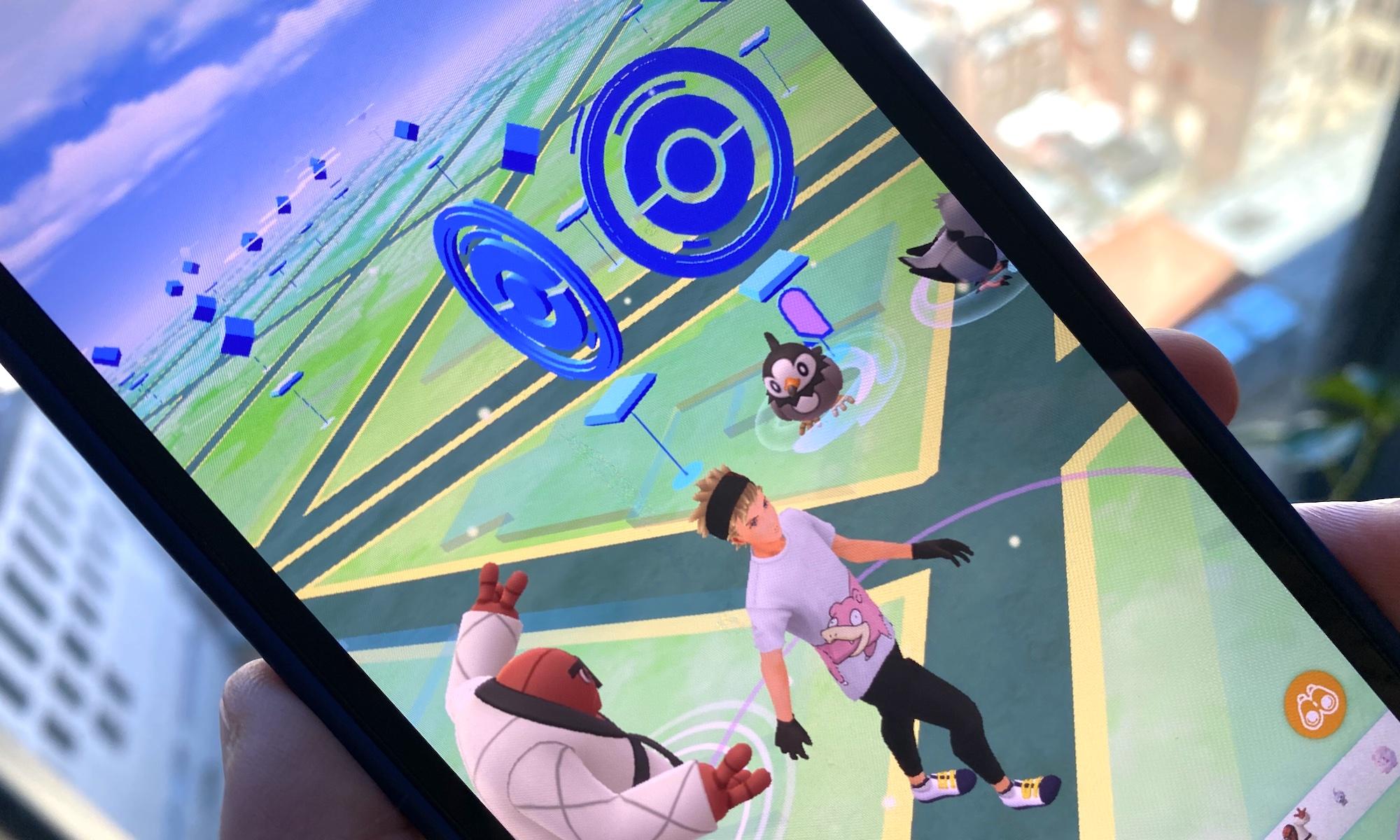 A trainer walks near Pokestops in a photo of Pokémon Go running on an iPhone