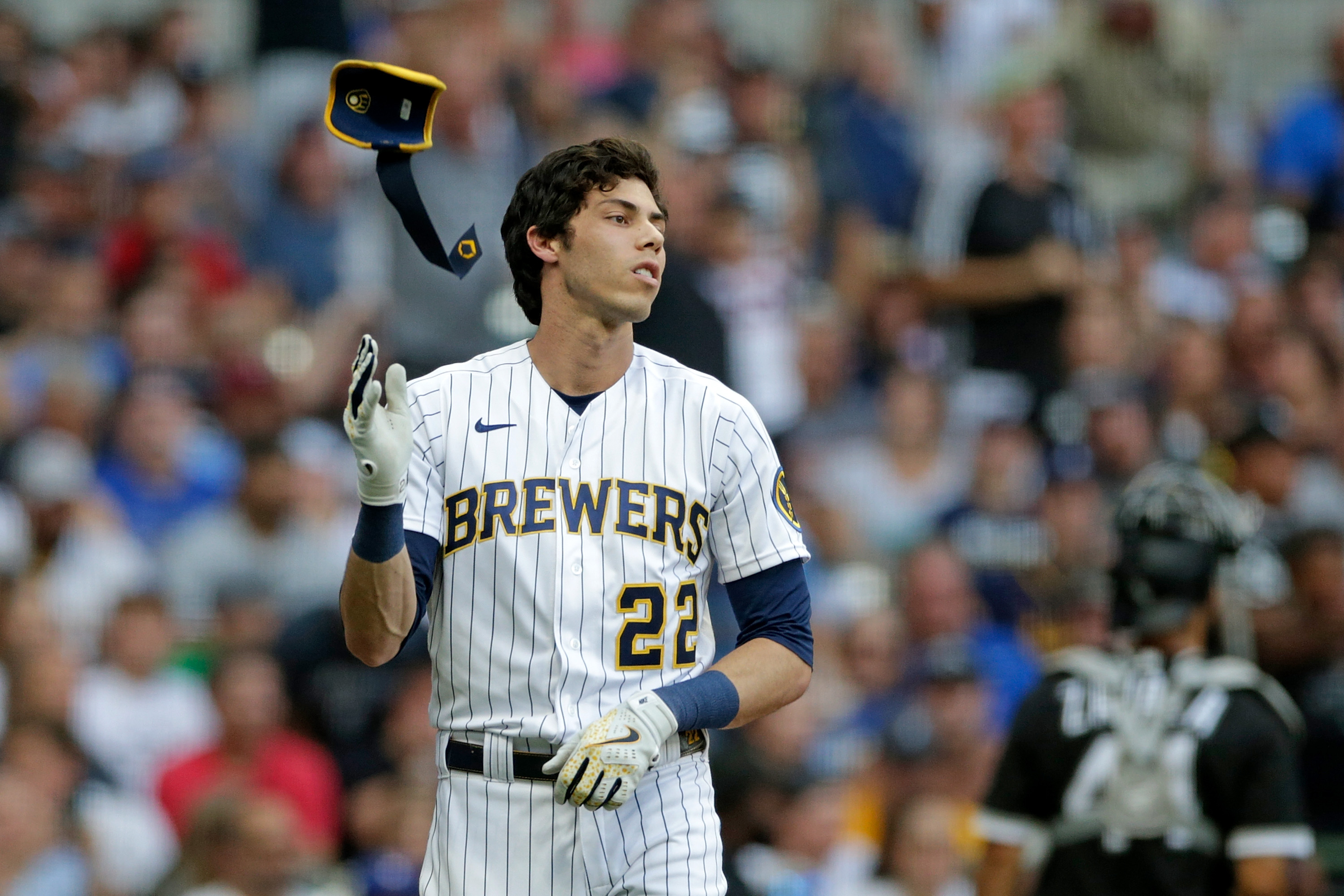 Christian Yelich #22 of the Milwaukee Brewers strikes out in the third inning against the Chicago White Sox at American Family Field on July 25, 2021 in Milwaukee, Wisconsin.