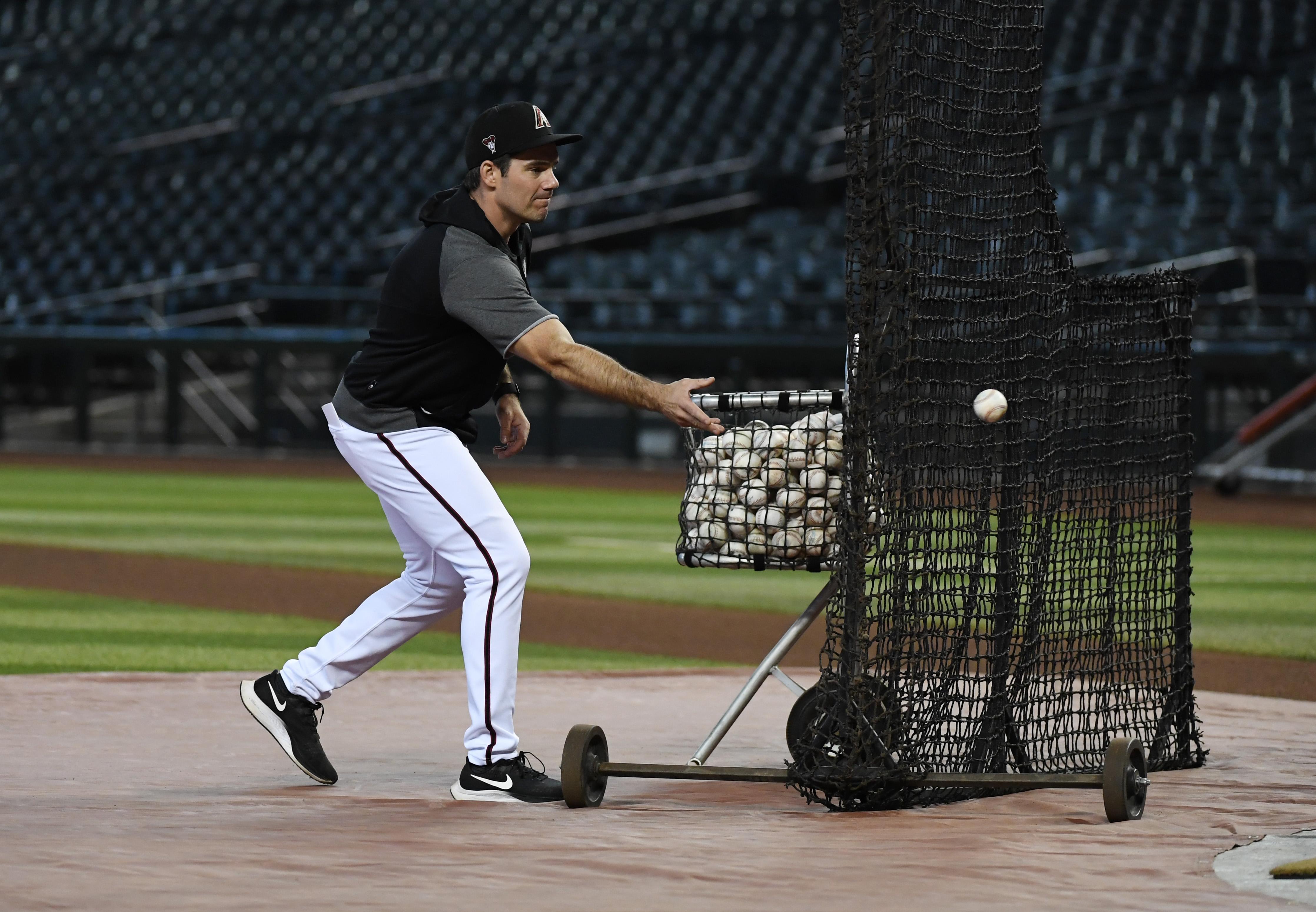 Co-Hitting coach Drew Hedman tosses balls in batting practice.
