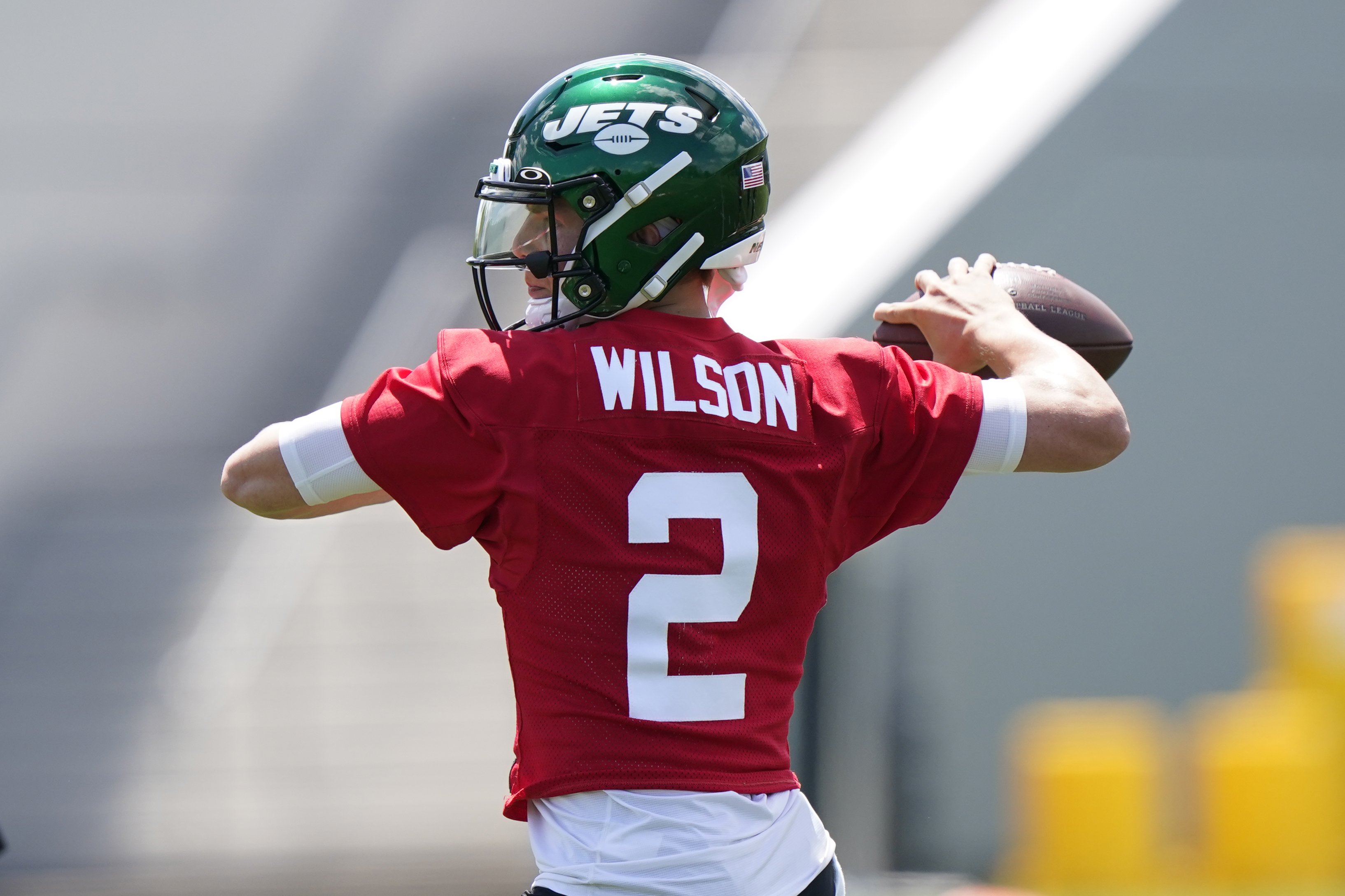 New York Jets quarterback Zach Wilson passes the ball during an NFL football practice.