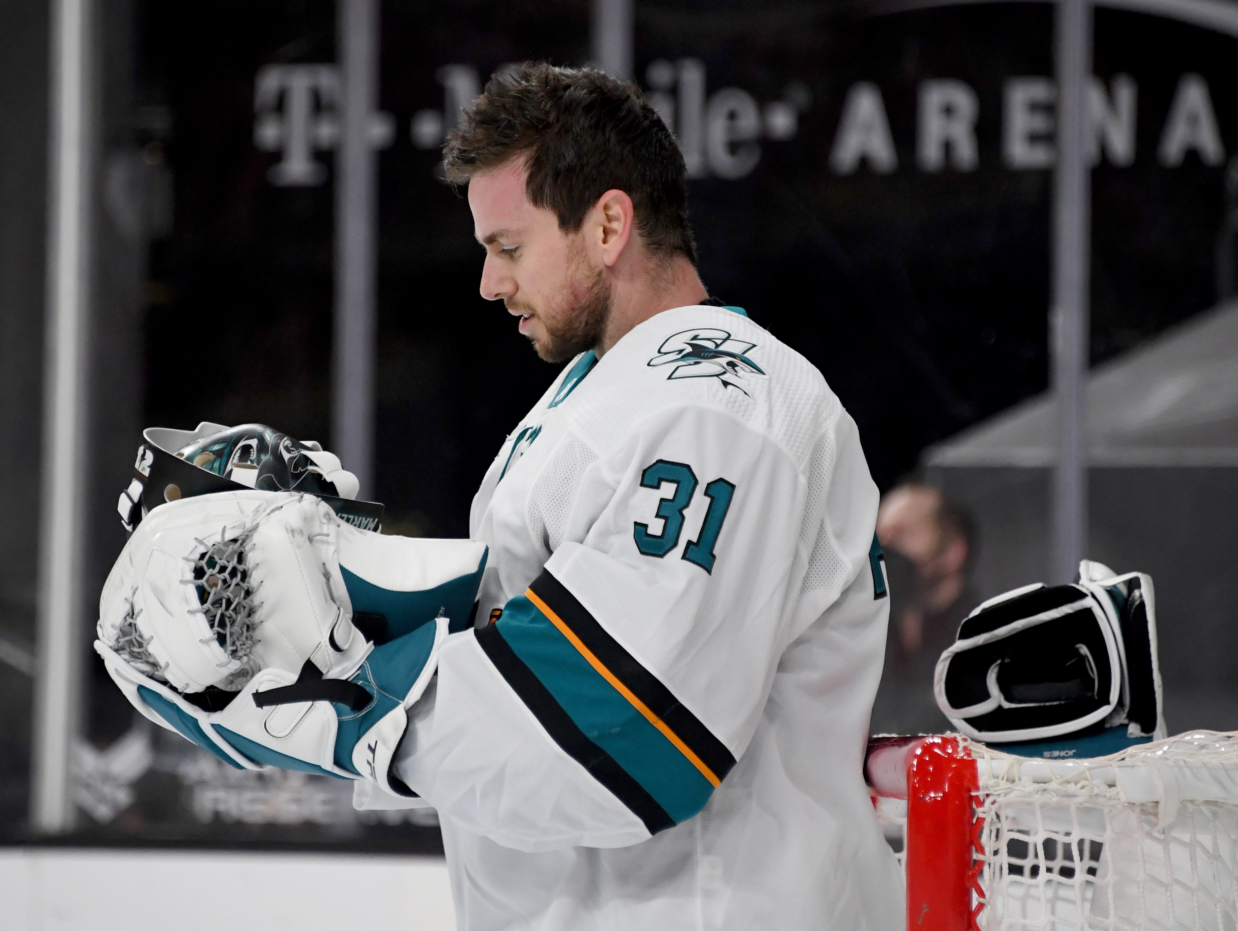 Martin Jones #31 of the San Jose Sharks takes a break during a stop in play during overtime of a game against the Vegas Golden Knights at T-Mobile Arena on April 19, 2021 in Las Vegas, Nevada. The Golden Knights defeated the Sharks 3-2 in a shootout.