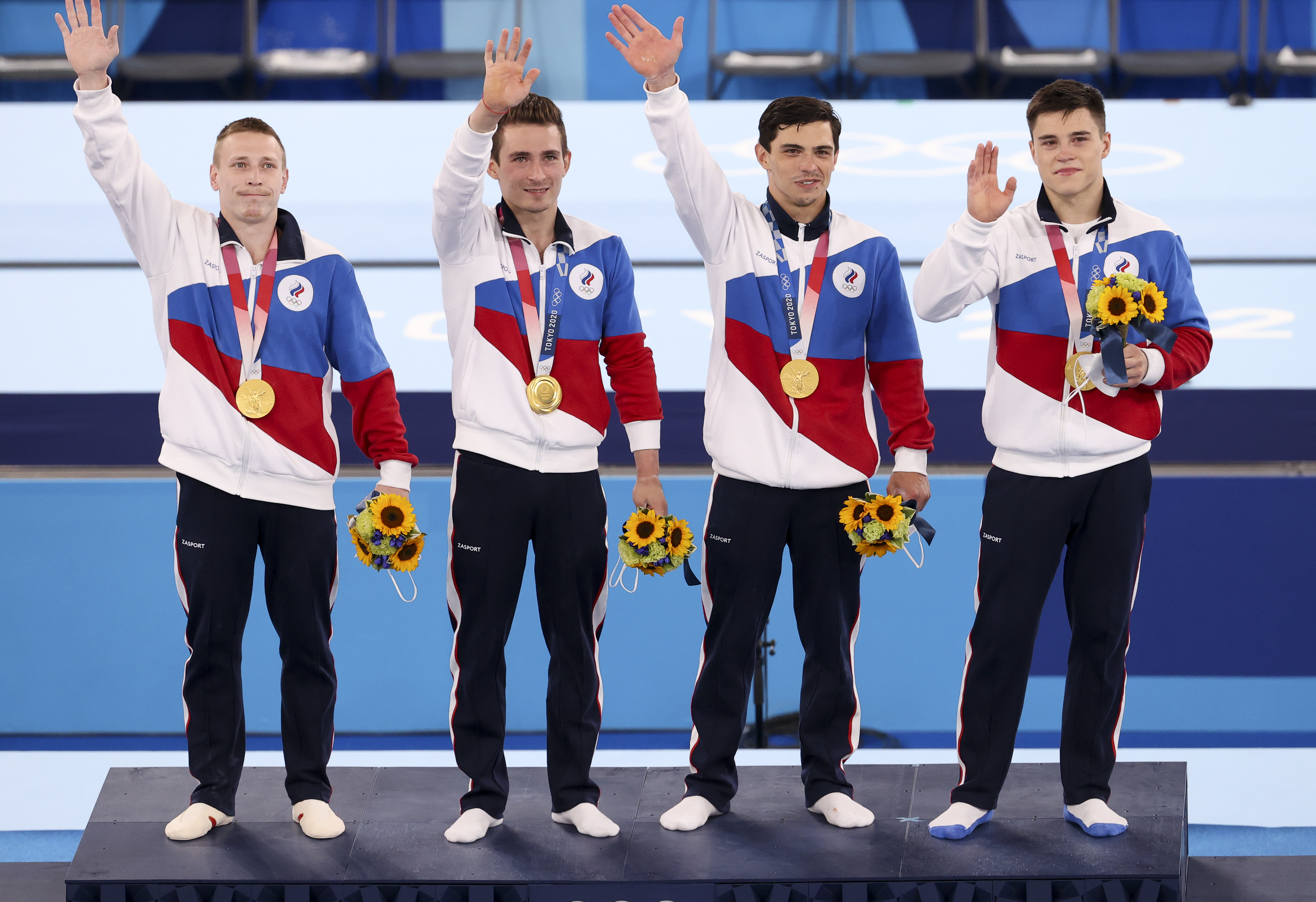 Gold medalists Denis Abliazin, David Belyavskiy, Artur Dalaloyan and Nikita Nagornyy of Team Russia react on the podium during the medal ceremony in the gymnastics artistic Men's Team Final on day three of the Tokyo 2020 Olympic Games at Ariake Gymnastics Centre on July 26, 2021 in Tokyo, Japan.