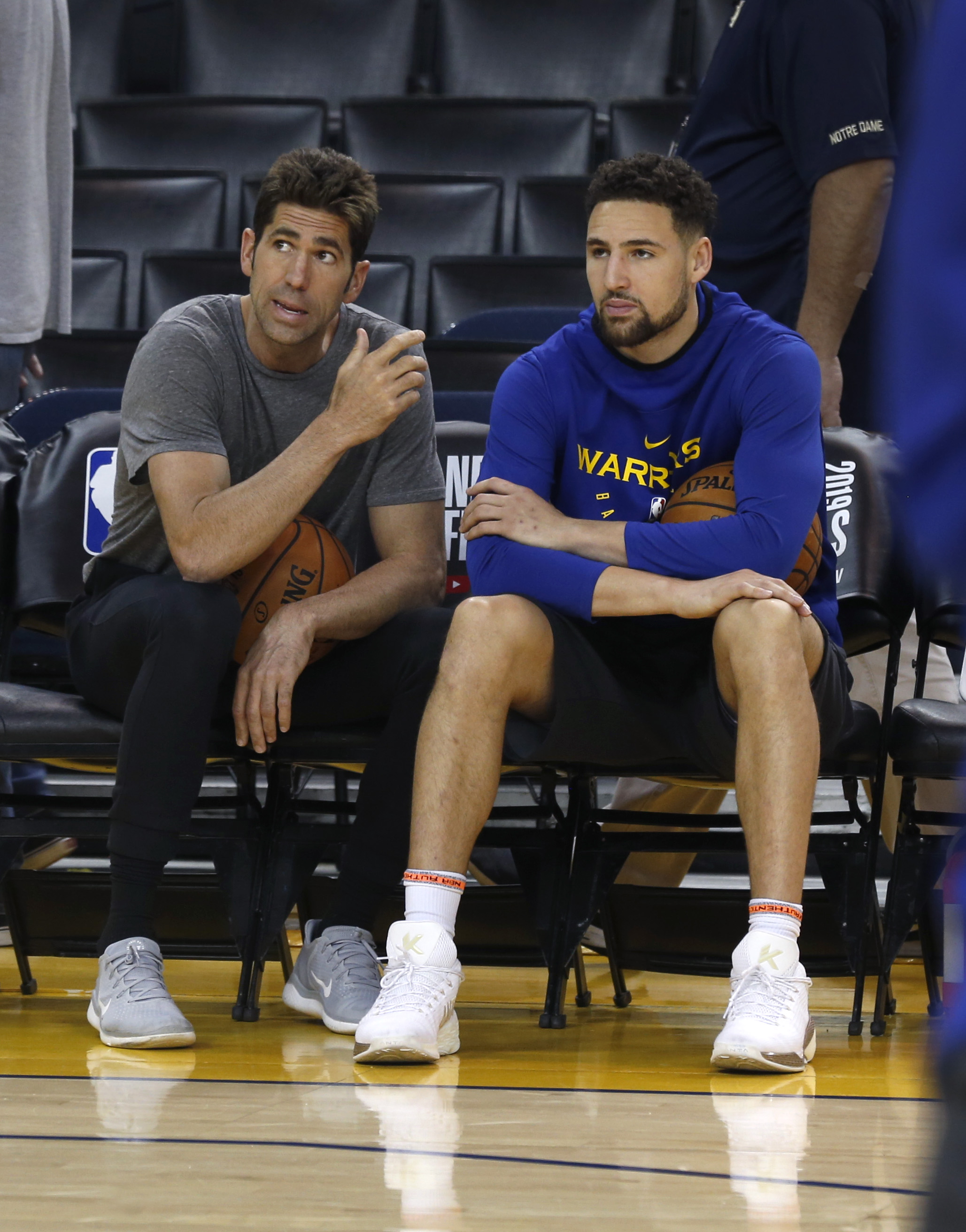 General manager Bob Myers speaks with Klay Thompson during a Golden State Warriors practice at Oracle Arena in Oakland, Calif. on Tuesday, June 4, 2019 before tomorrow's Game 3 of the NBA Finals against the Toronto Raptors.