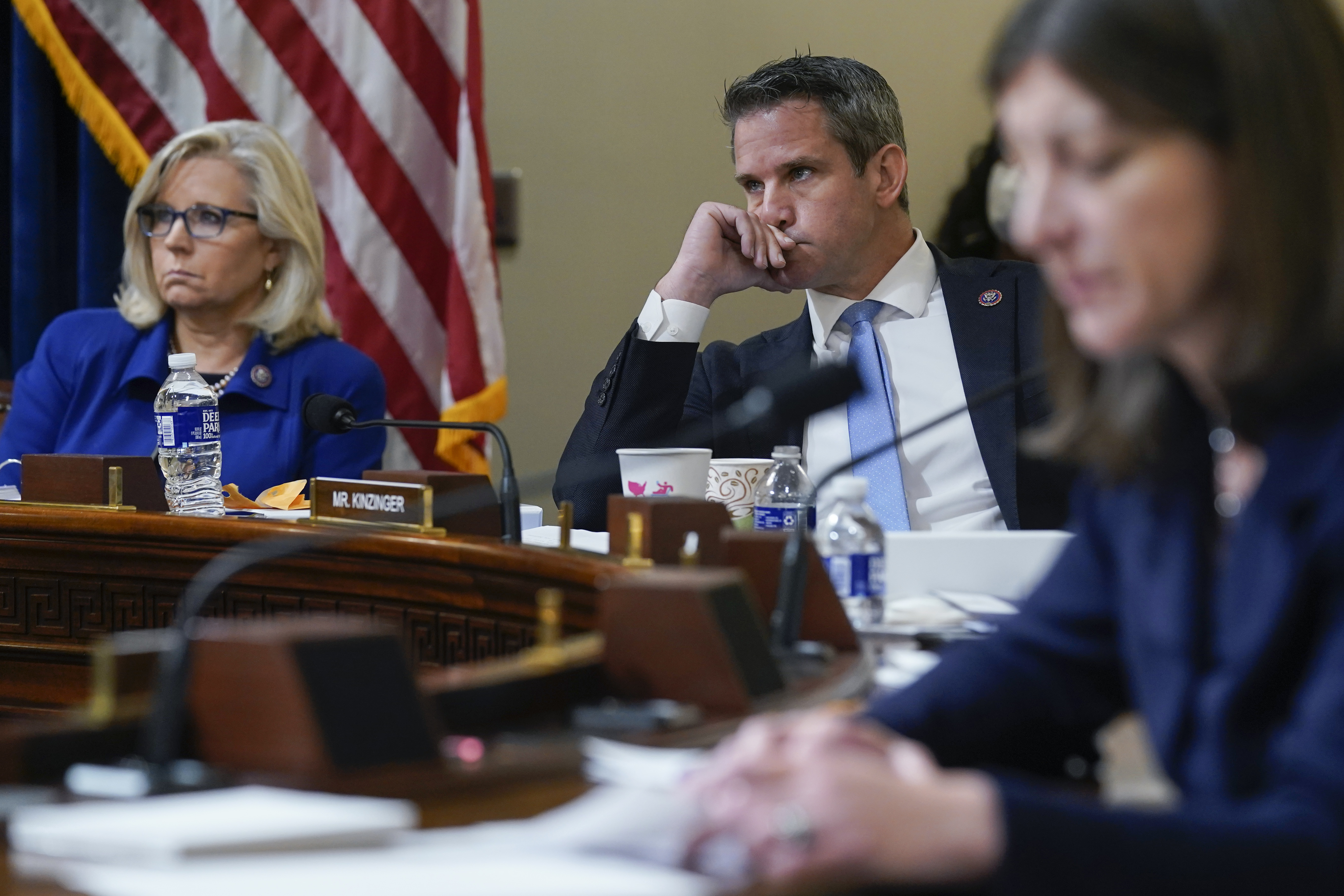 Rep. Liz Cheney, R-Wyo., and Rep. Adam Kinzinger, R-Ill., listen during the House select committee hearing on the Jan. 6 attack.