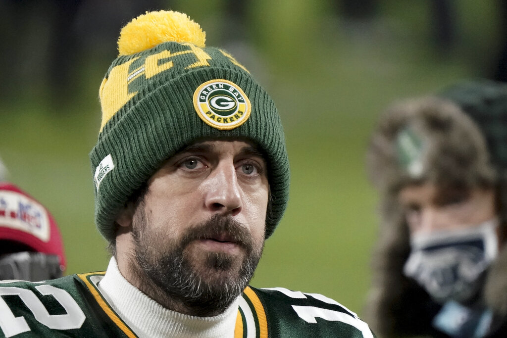 Green Bay Packers quarterback Aaron Rodgers (12) walks off the field after the NFC championship game.