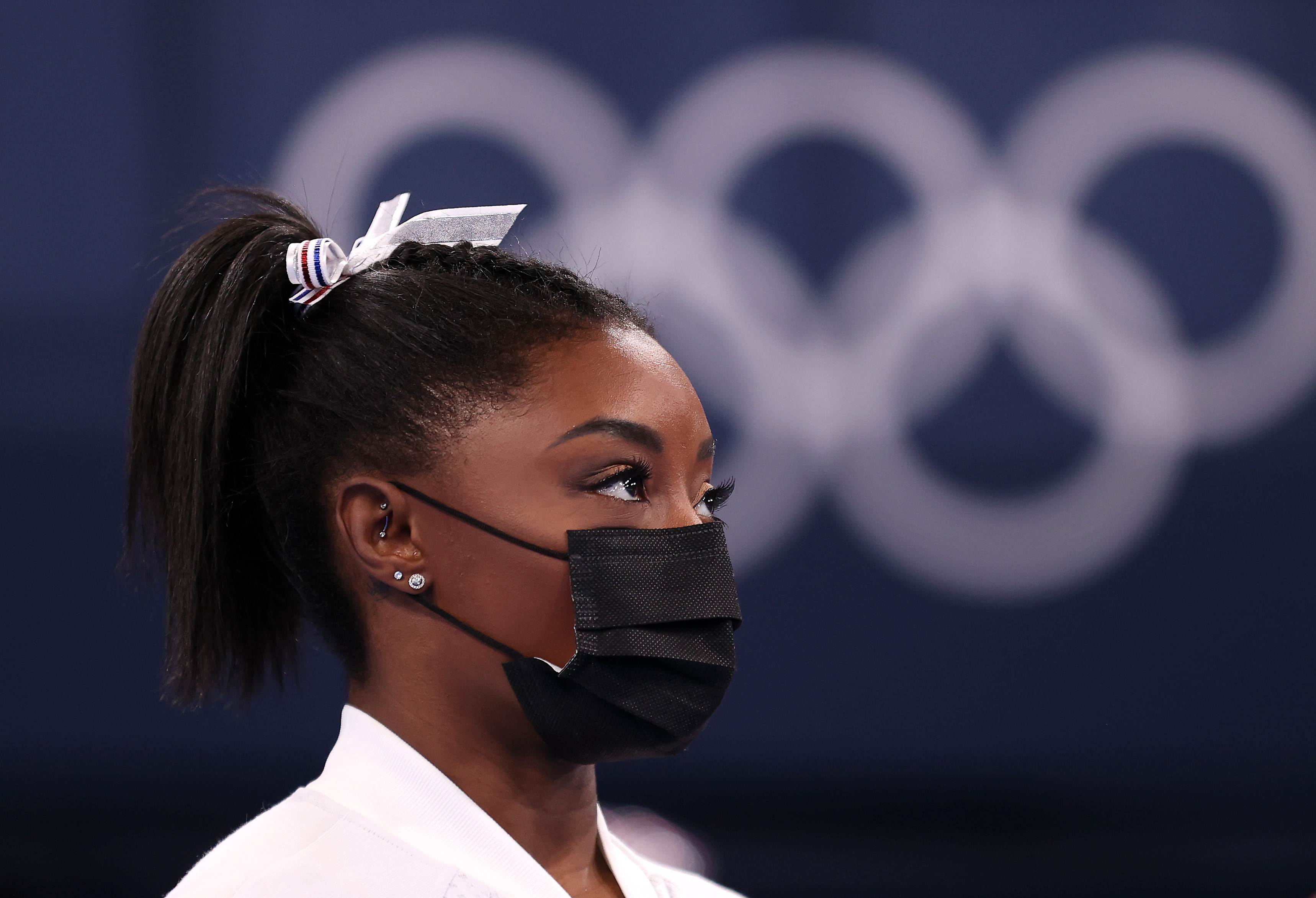 Gymnast Simone Biles, wearing a mask.