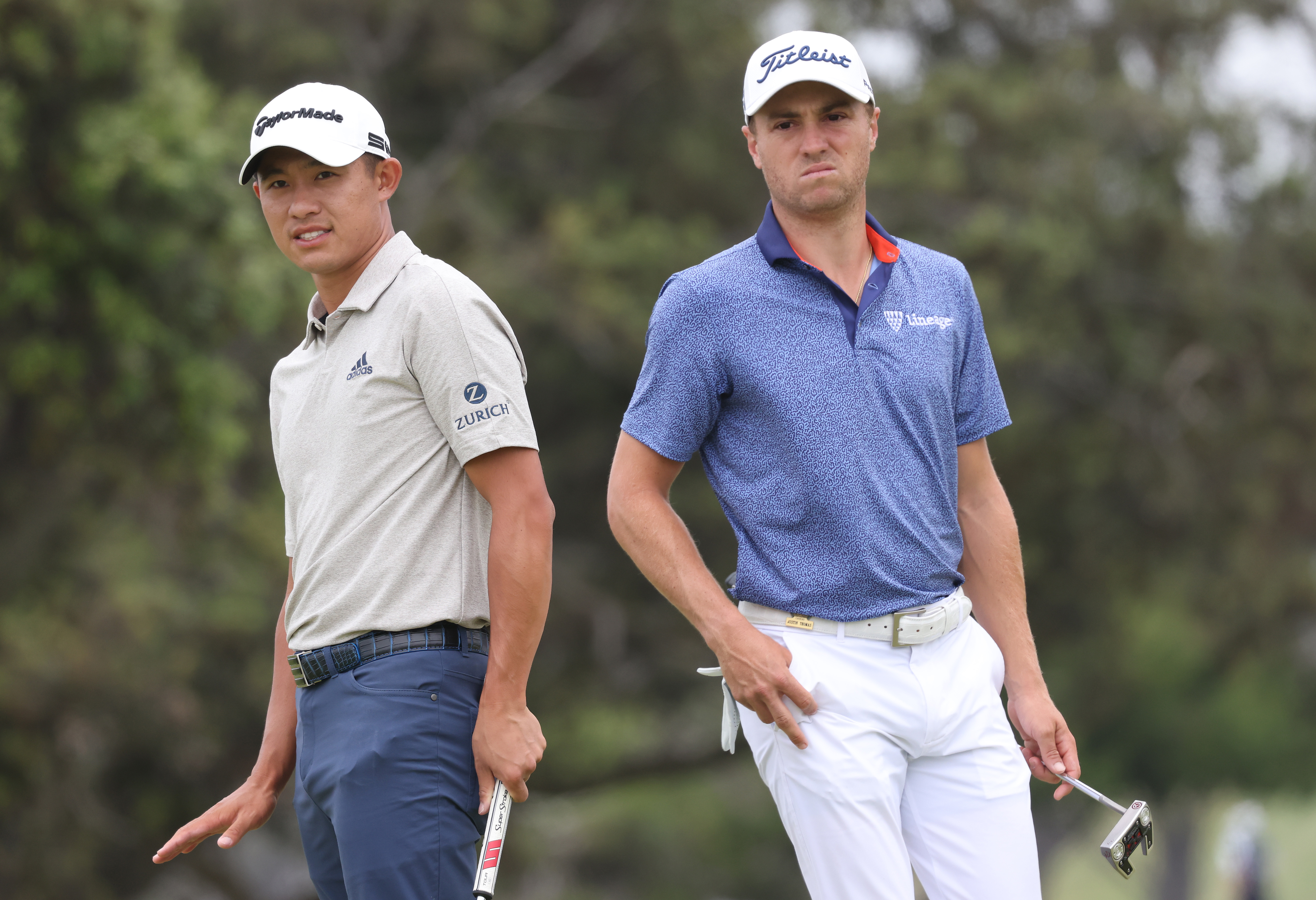 Justin Thomas (R) of the United States and Collin Morikawa (L) of the United States watch Morikawa's putt on the second green during the third round of the 2021 U.S. Open at Torrey Pines Golf Course (South Course) on June 19, 2021 in San Diego, California.