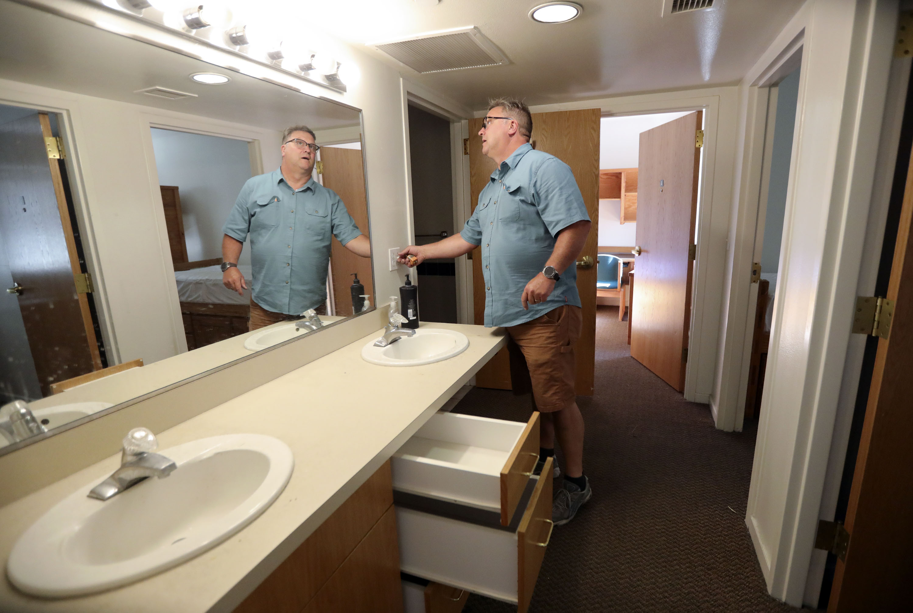 Mark Vittum, Westminster College maintenance technician, checks lightbulbs and power outlets in an Olwell Hall dorm at Westminster College in Salt Lake City on Tuesday, June 22, 2021.