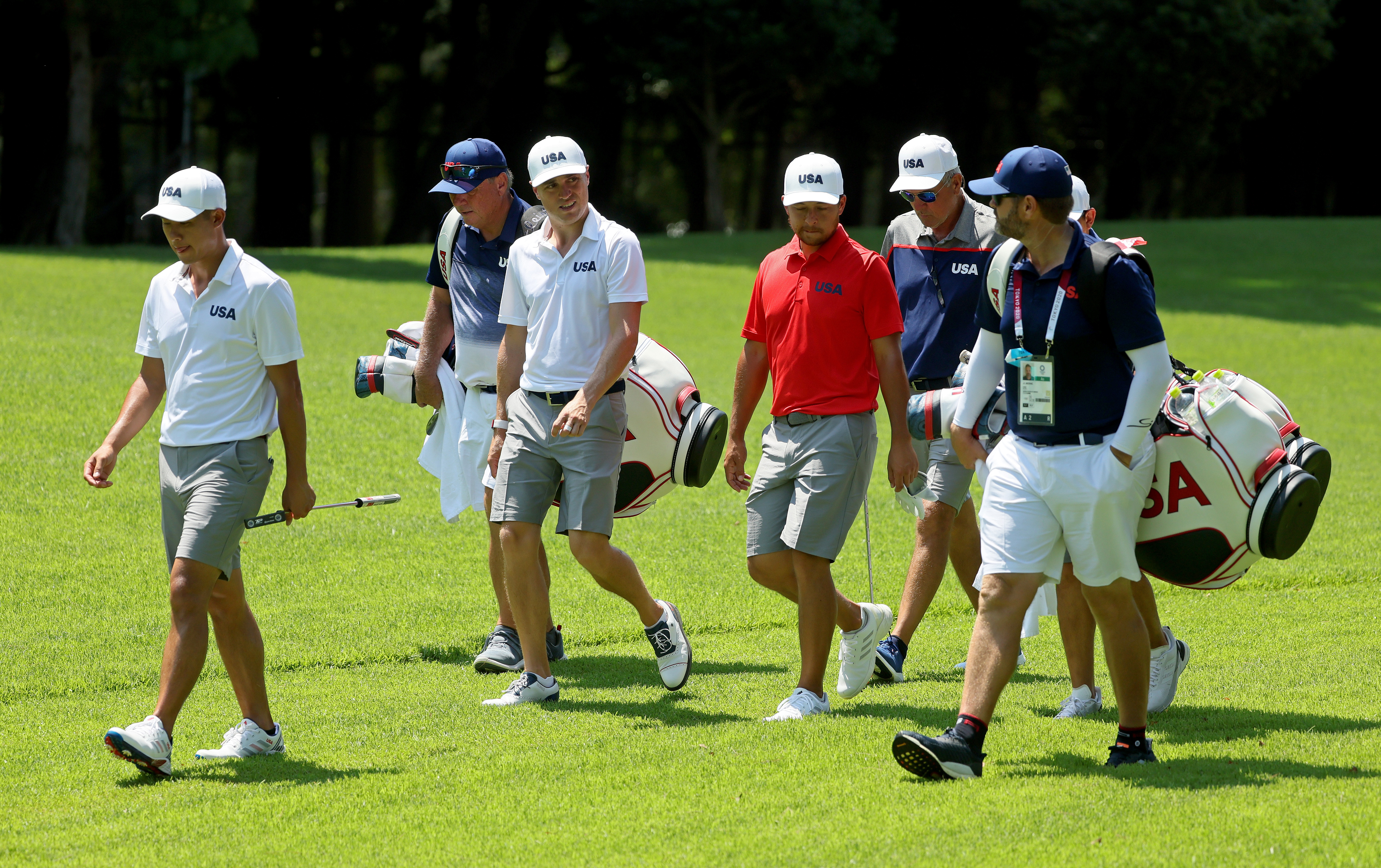 Xander Schauffele, Justin Thomas, and Collin Morikawa of Team USA play during a practice round at Kasumigaseki Country Club ahead of the Tokyo Olympic Games on July 28, 2021 in Tokyo, Japan.