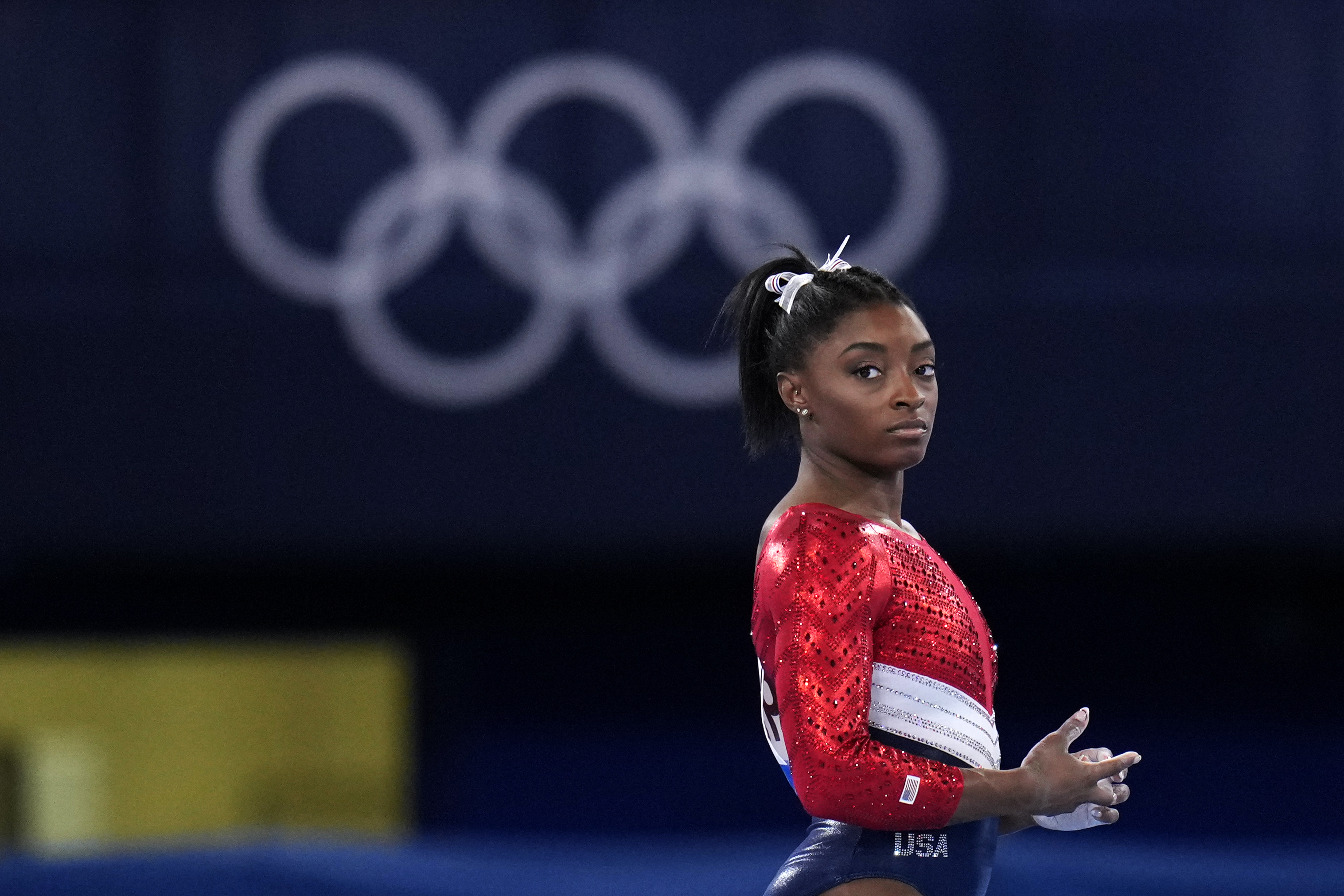 U.S. superstar gymnast Simone Biles waits to perform on the vault during the artistic gymnastics women's final at the 2020 Summer Olympics.