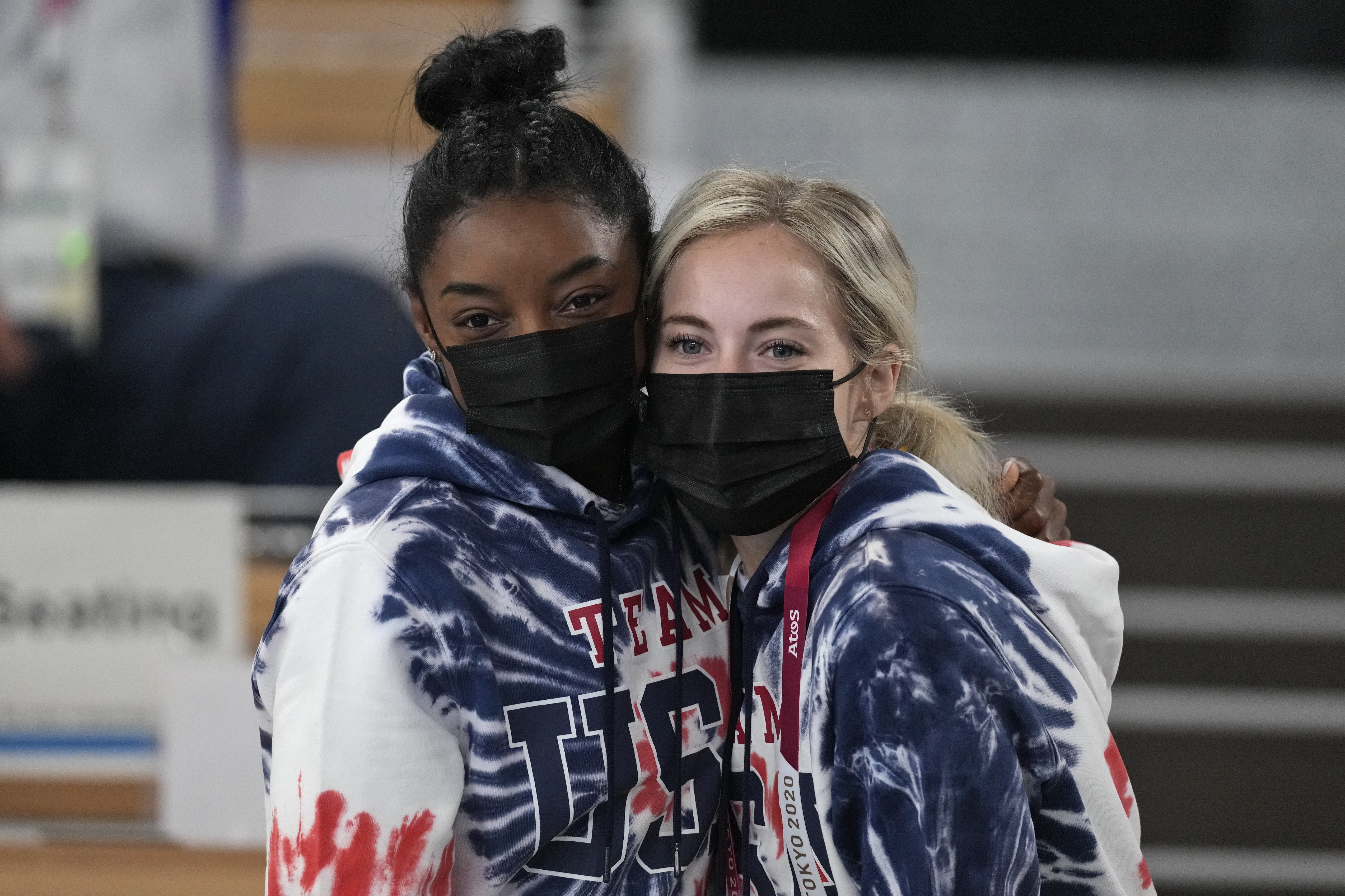 Simone Biles, of United States, poses with teammate Mykayla Skinner as they watch the artistic gymnastics men's all-around final.