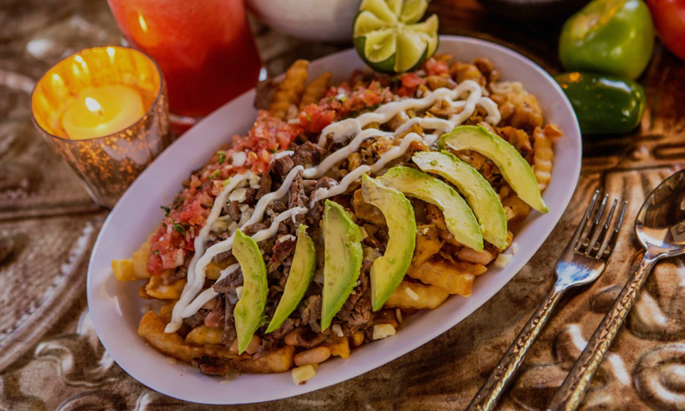 Carne asada fries on the fast casual menu at Frijoles & Frescas.