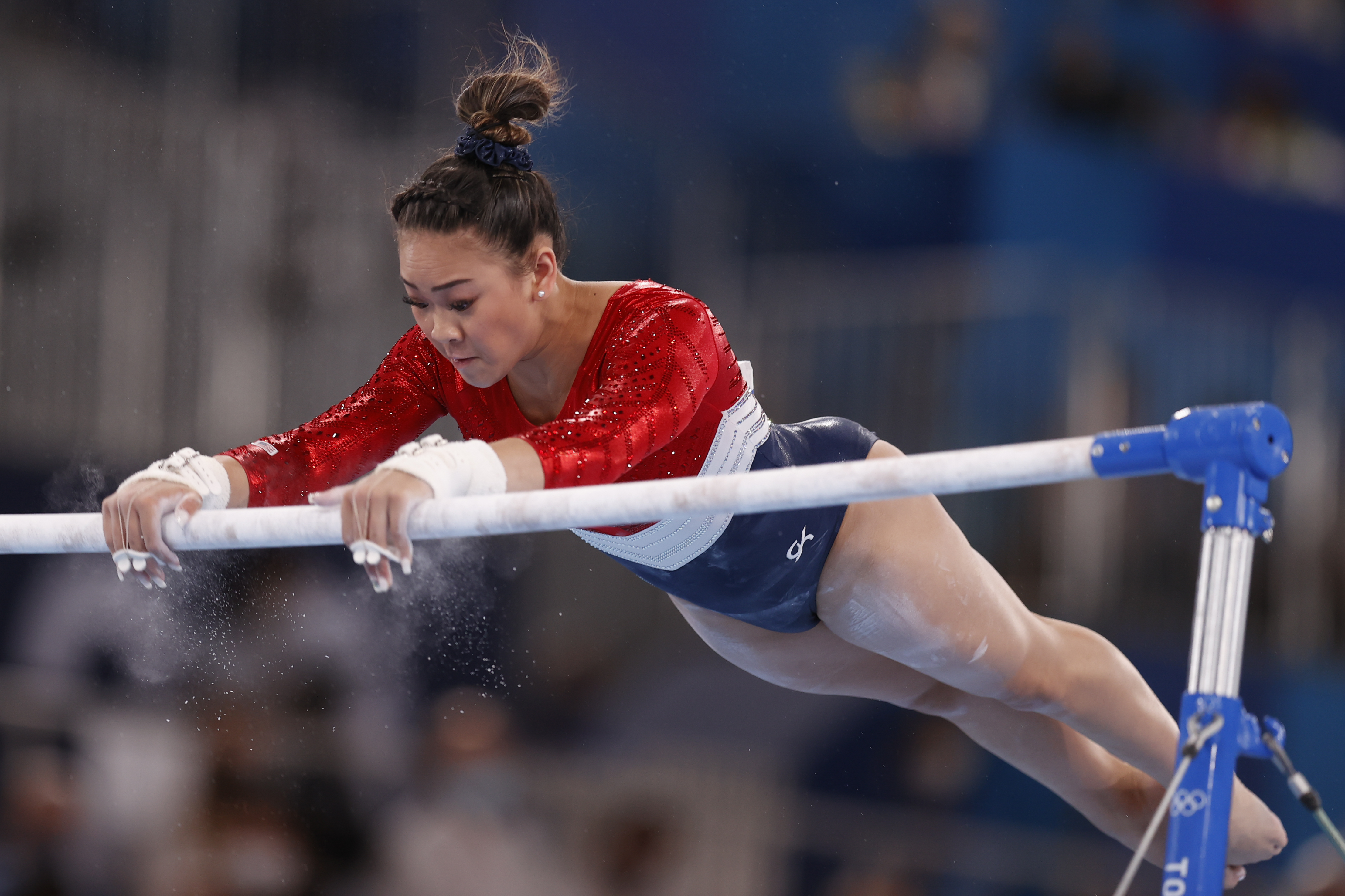 Sunisa Lee of Team United States competes in the uneven bars during the Women's Team Final on day four of the Tokyo 2020 Olympic Games at Ariake Gymnastics Centre on July 27, 2021 in Tokyo, Japan.