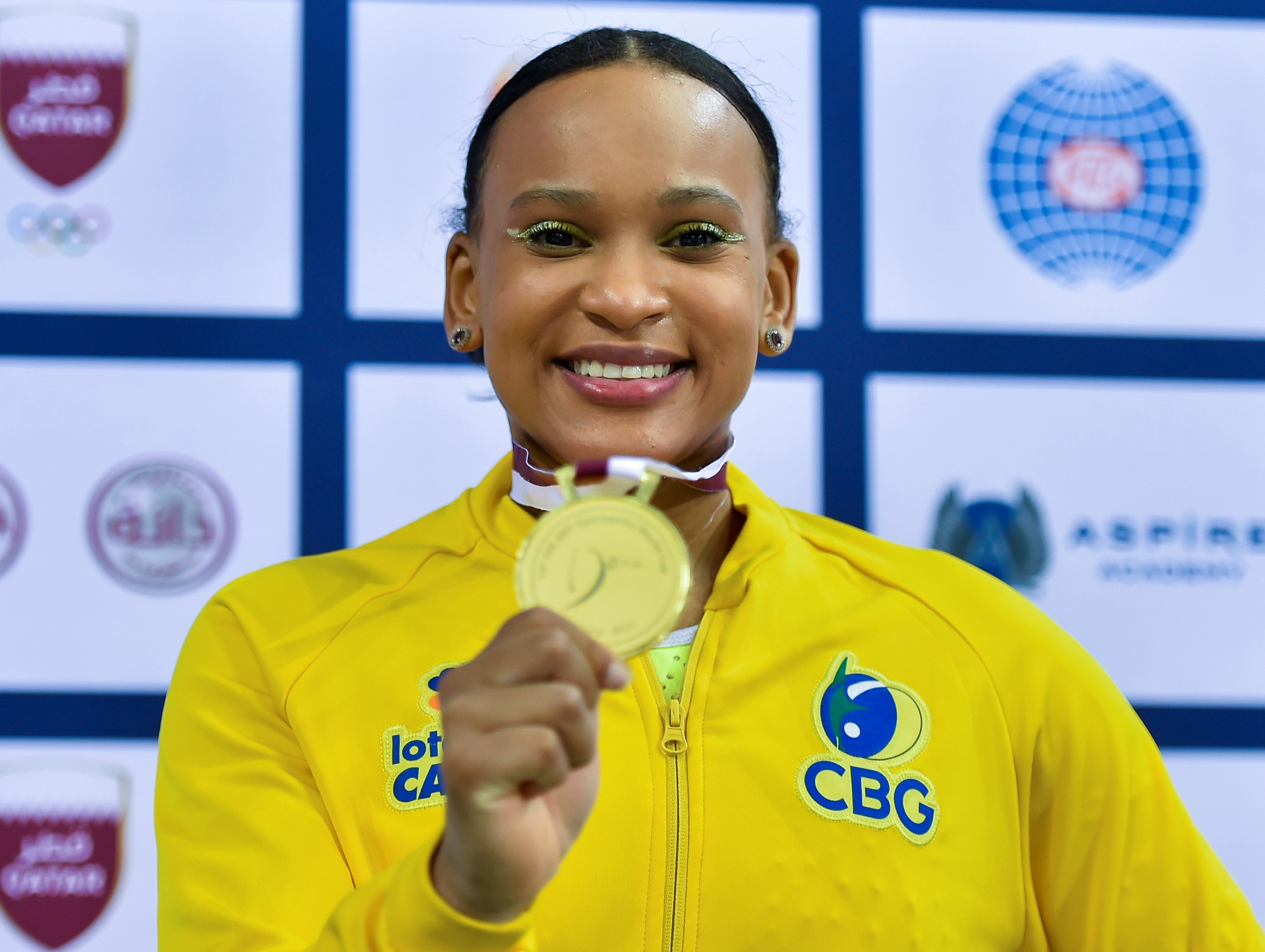 Rebeca Andrade of Brazil poses during the awarding ceremony for the Women's Uneven Bars Final at the 13th FIG Artistic Gymnastics World Cup in Doha, capital of Qatar, on June 25, 2021.