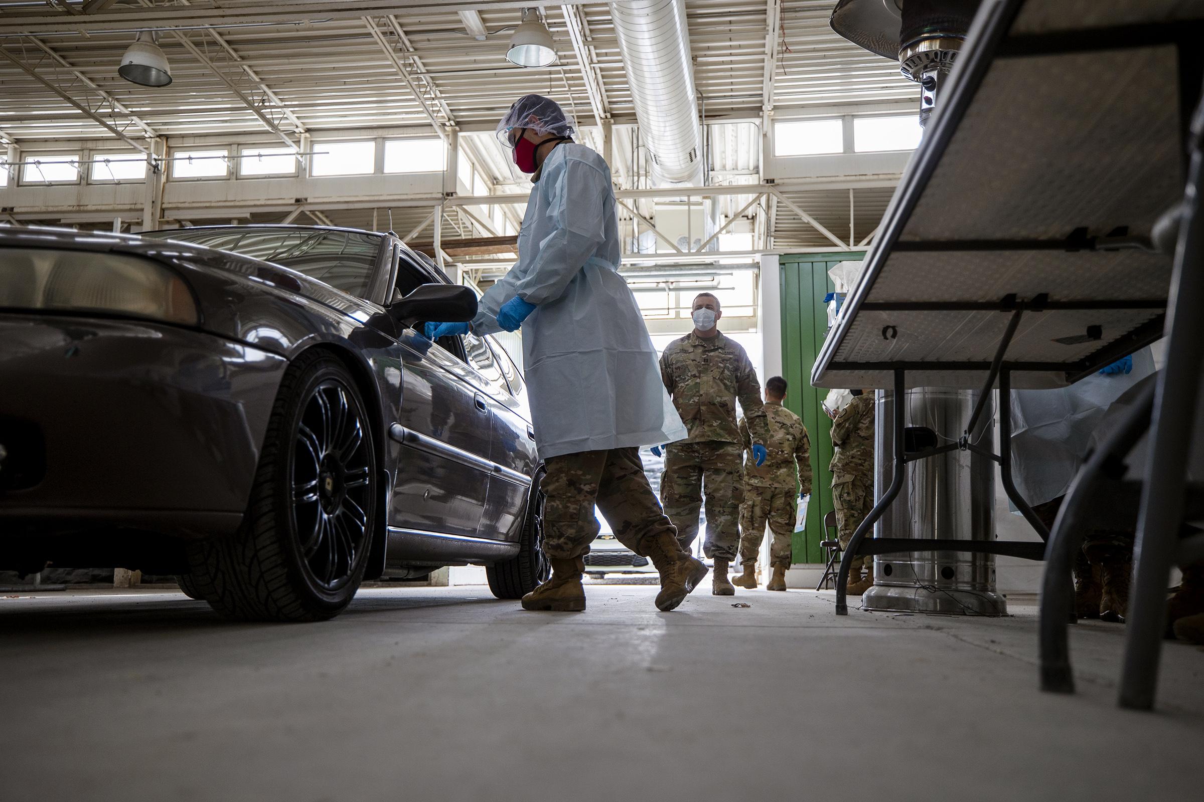 Members of the Utah National Guard work at a COVID-19 testing center
