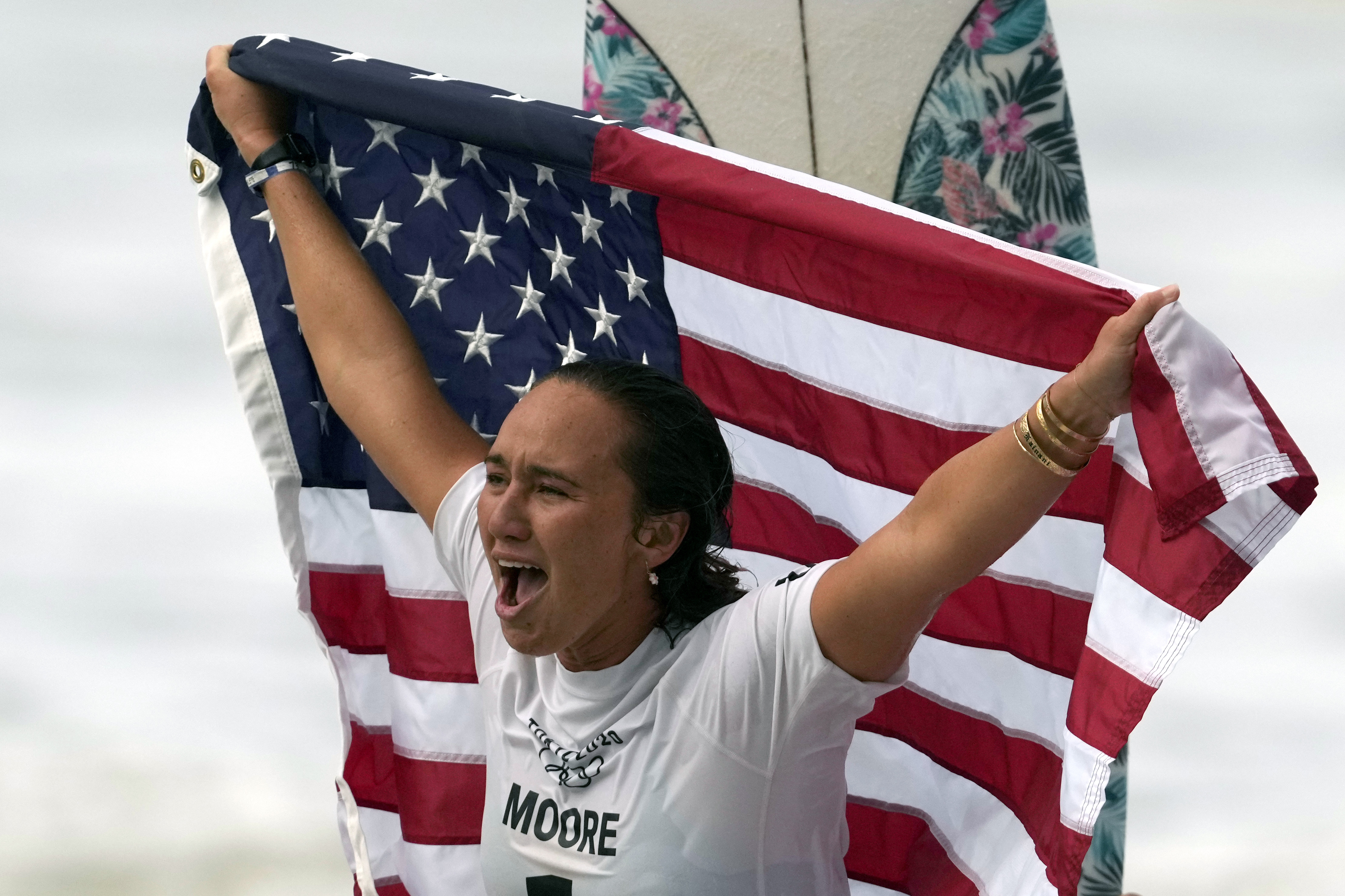 Carissa Moore of the United States celebrates winning the gold medal in surfing at the 2020 Summer Olympics.