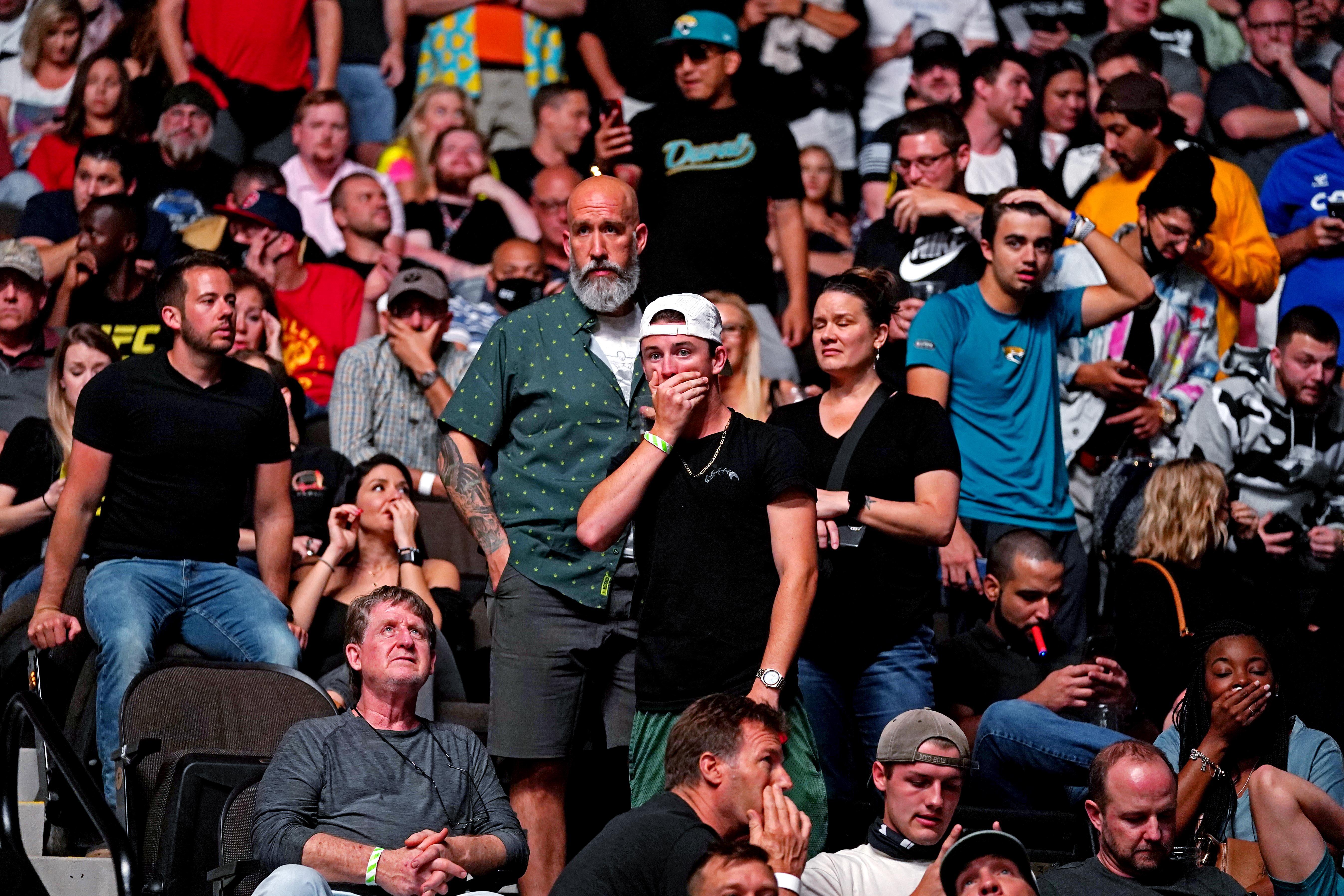 Fans react to Chris Weidman's broken leg against Uriah Hall at UFC 261.