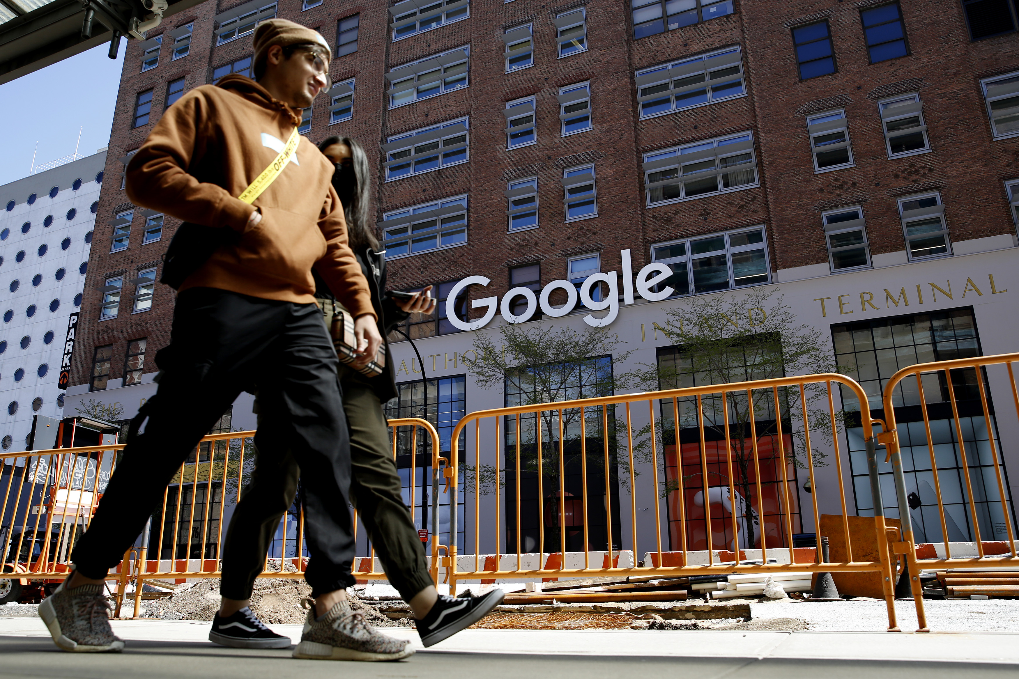People walk past a Google building in New York.