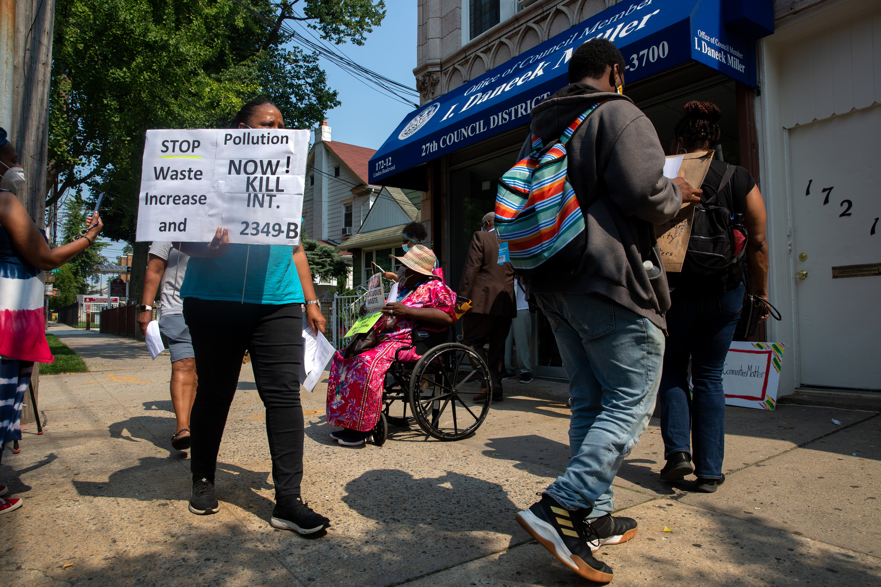 Southeast Queens community members protest a waste transfer station outside Councilmember Daneek Miller's St. Albans office, July 27, 2021.