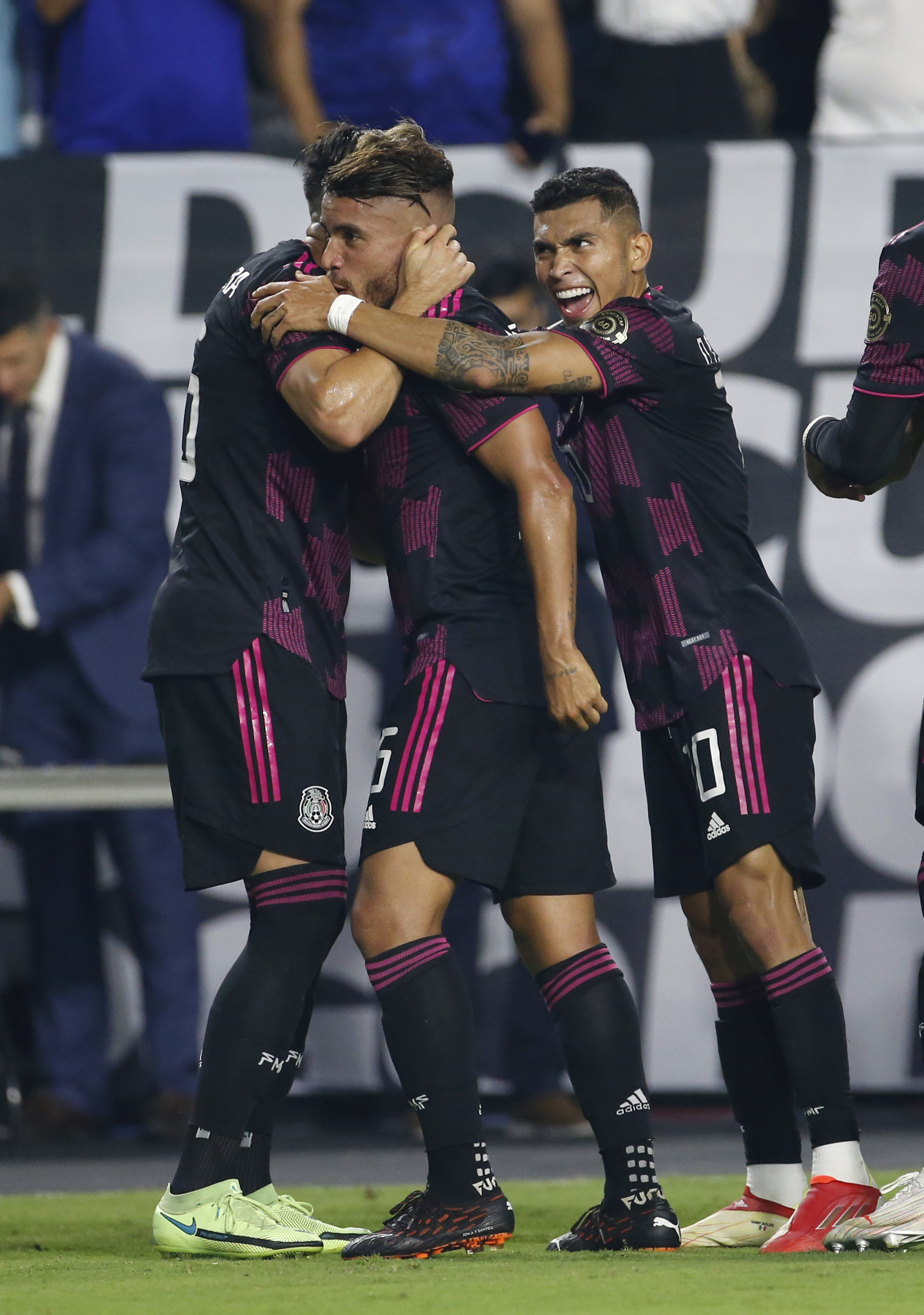 Jonathan Dos Santos #6 of Mexico (C) celebrates with Hector Herrera #16 and Orbelin Pineda #10 of Mexico after scoring a goal against Honduras during the first half of the Concacaf Gold Cup quarterfinal match at State Farm Stadium on July 24, 2021 in Glendale, Arizona.